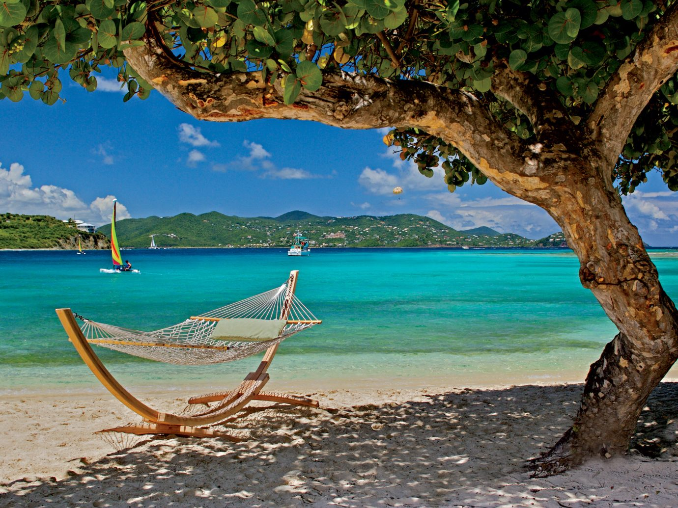 Beach Hotels Romance Rustic Tropical water outdoor shore tree body of water Sea Nature vacation Ocean tropics Coast bay Island caribbean Lagoon arecales