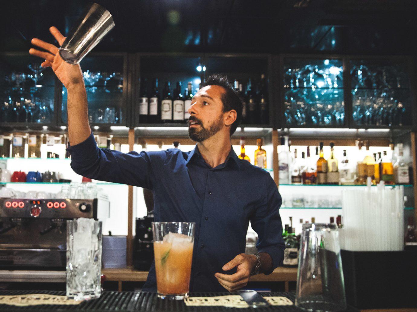 Budget Hotels London person indoor man appliance bartender sense Bar Drink drinking