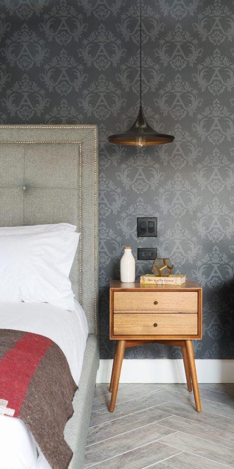 Jetsetter Guides indoor wall bed floor room furniture wood table interior design living room pillow Bedroom flooring