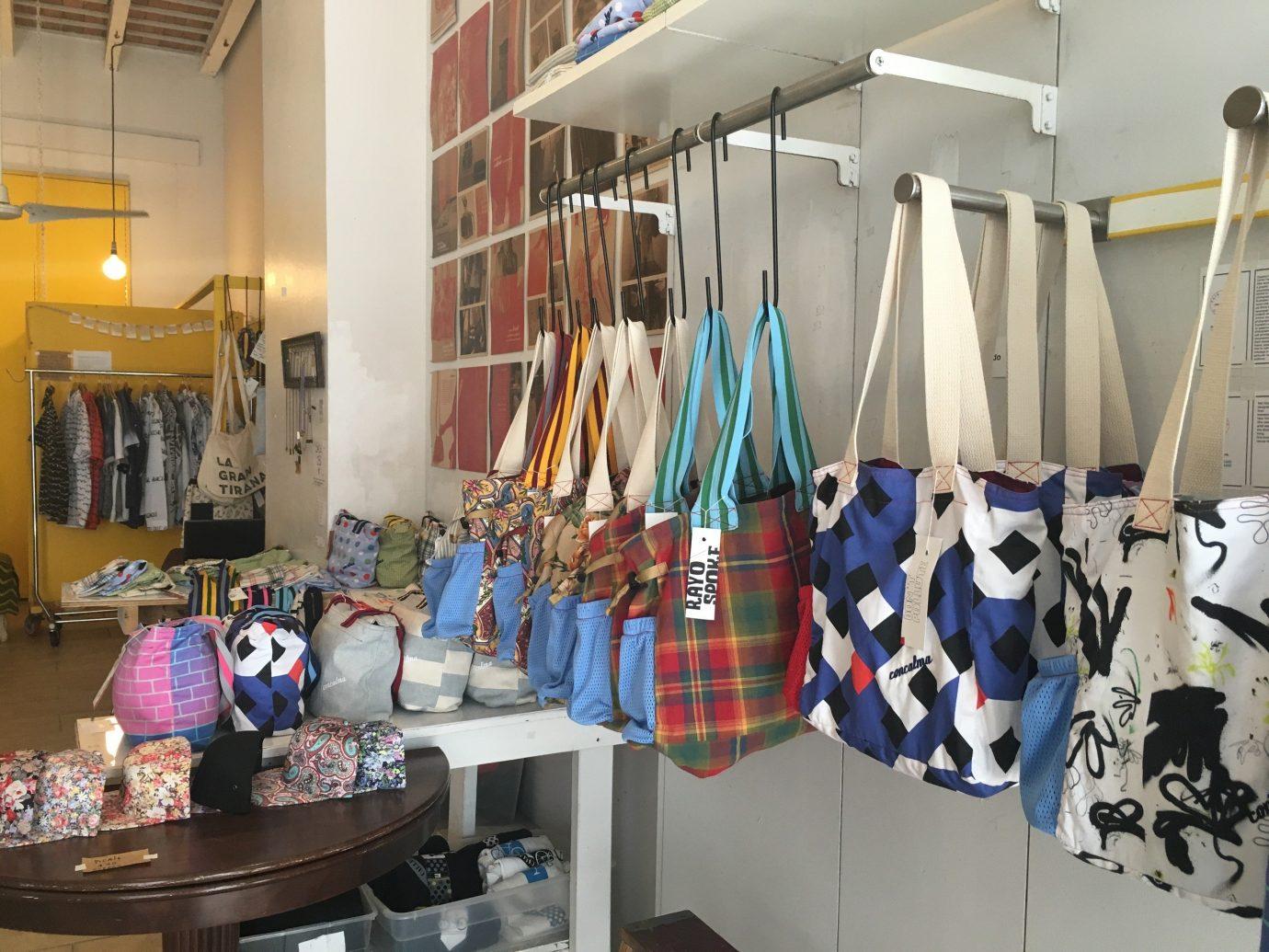 Jetsetter Guides indoor room Boutique hanging art interior design Design shopping cluttered several