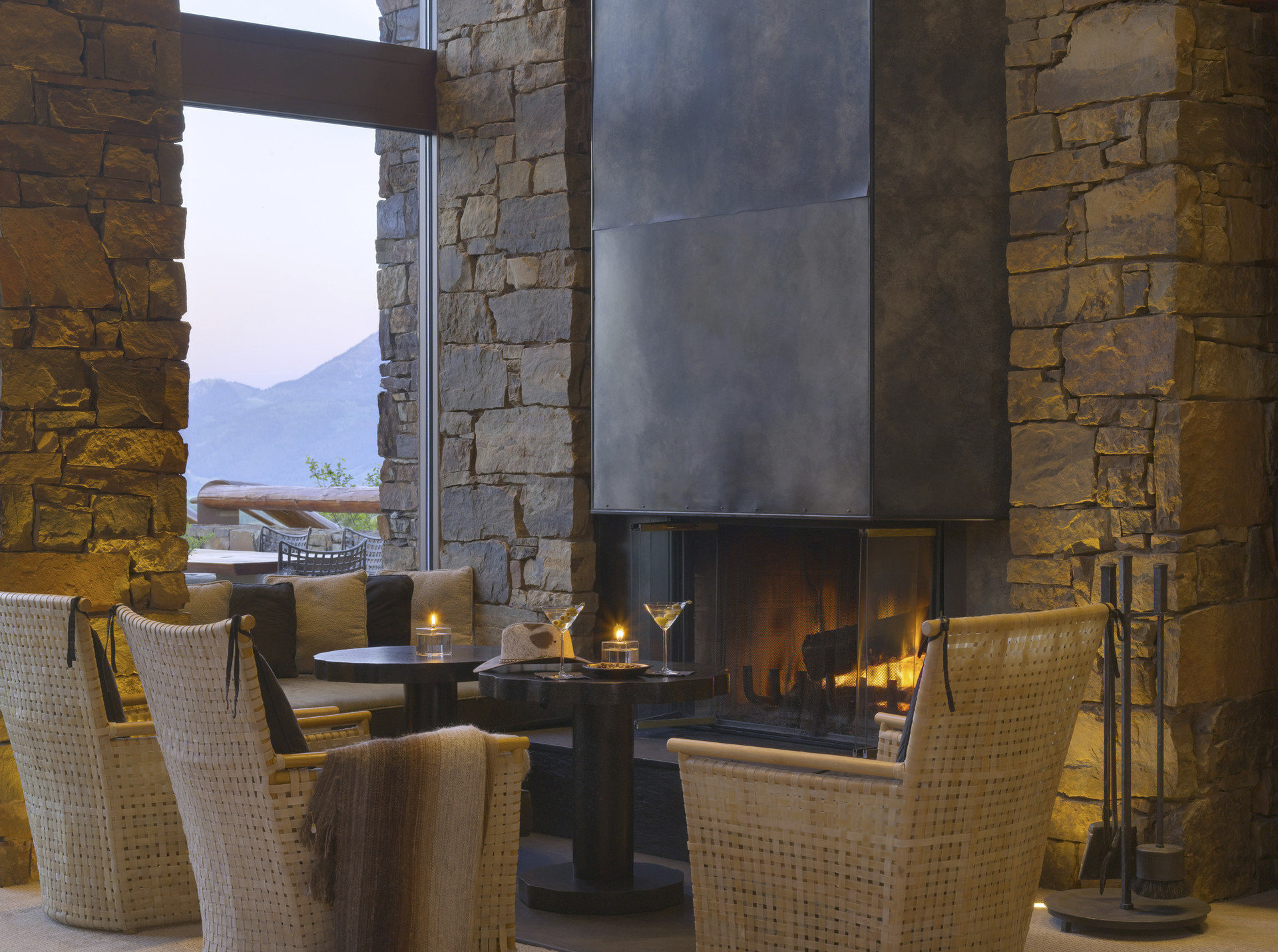 Hotels Luxury Travel Mountains + Skiing hearth Fireplace room building wall wood interior design home living room cottage stone area