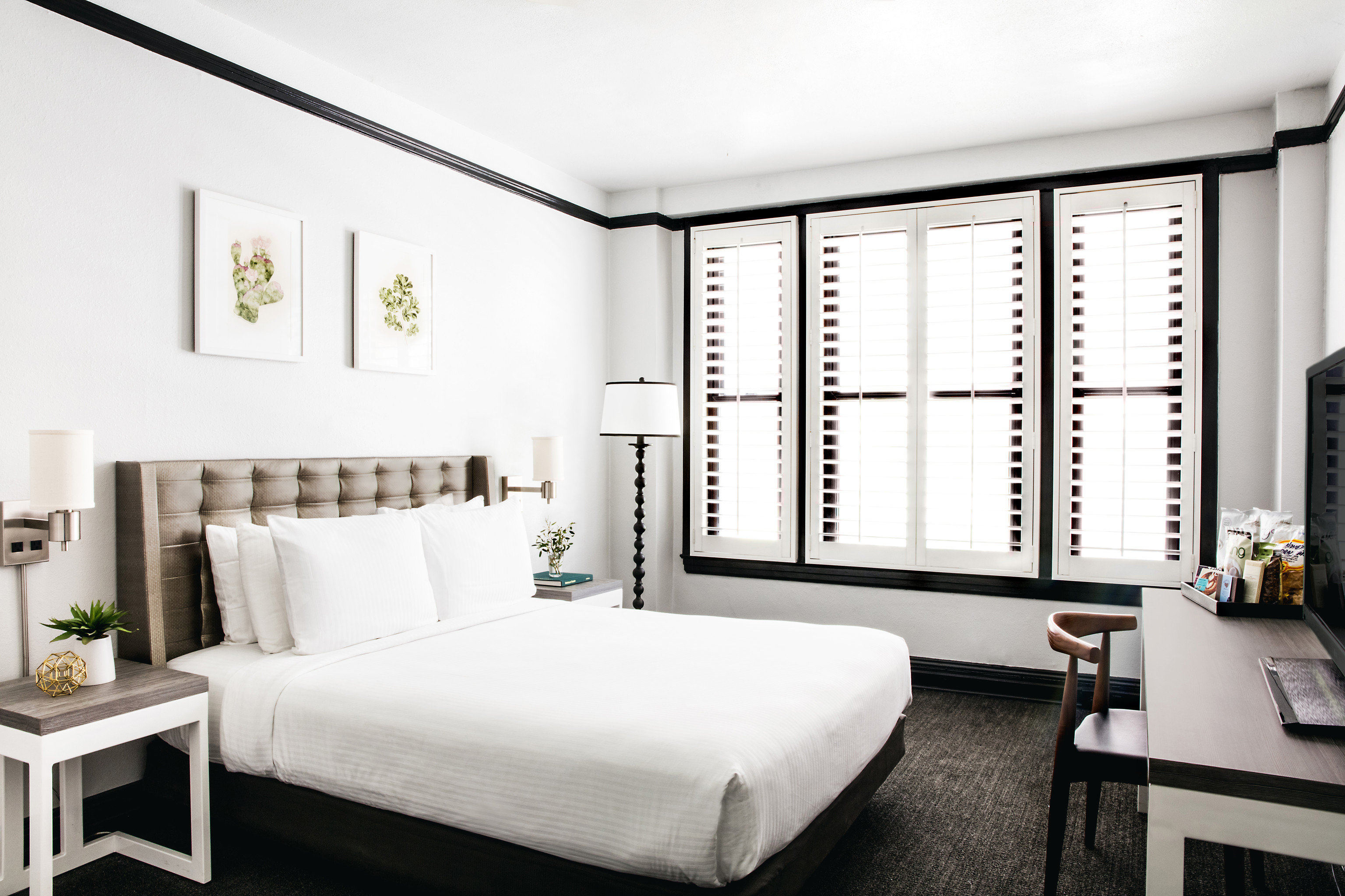 Hotels Travel Tips indoor wall floor room bed property hotel Bedroom living room interior design white home real estate furniture Design estate condominium Suite window covering ceiling apartment decorated