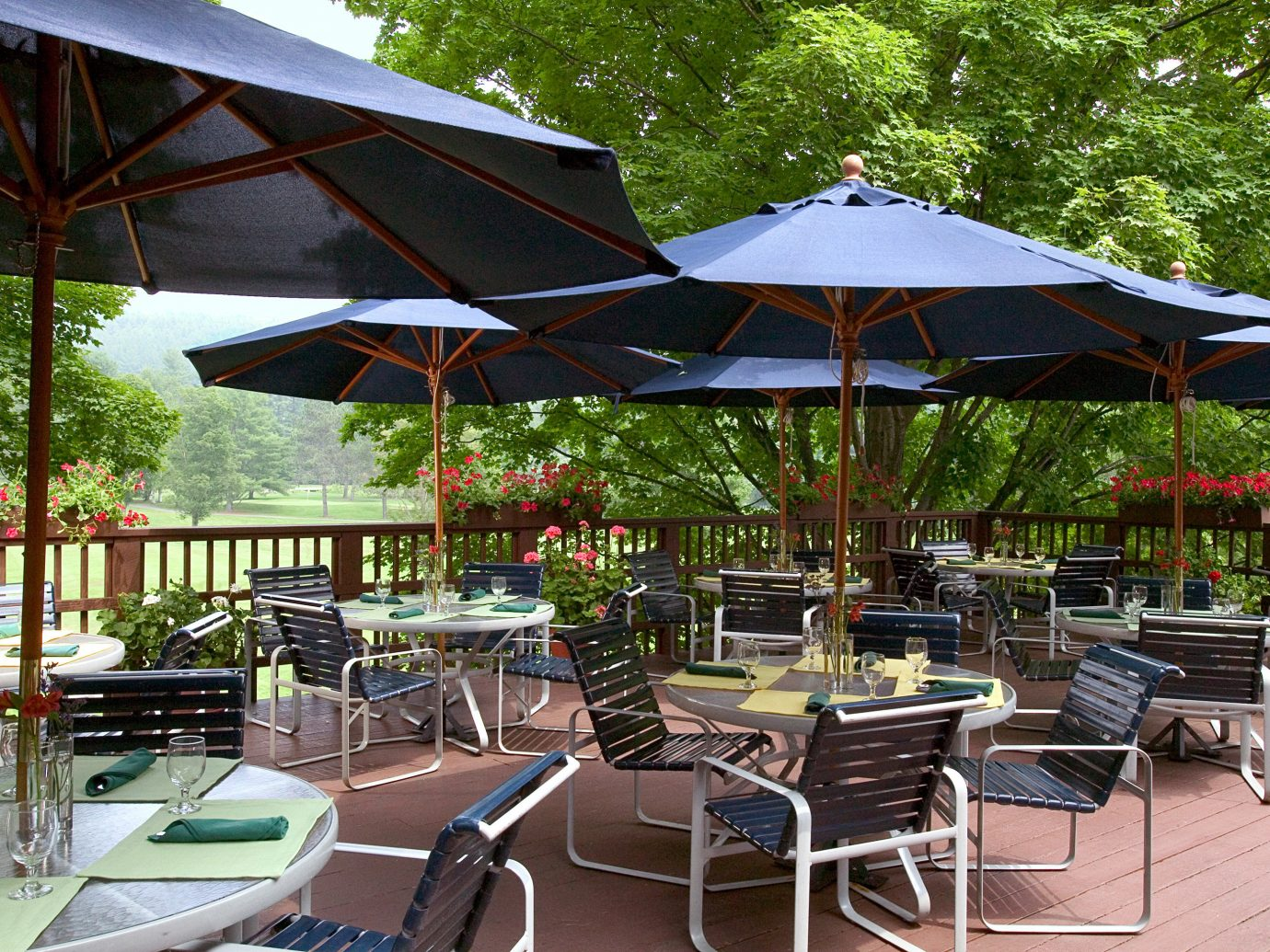 Country Deck Drink Eat Inn Patio Resort Trip Ideas tree table umbrella outdoor chair leisure tent Dining lawn canopy set restaurant outdoor structure area furniture shade several