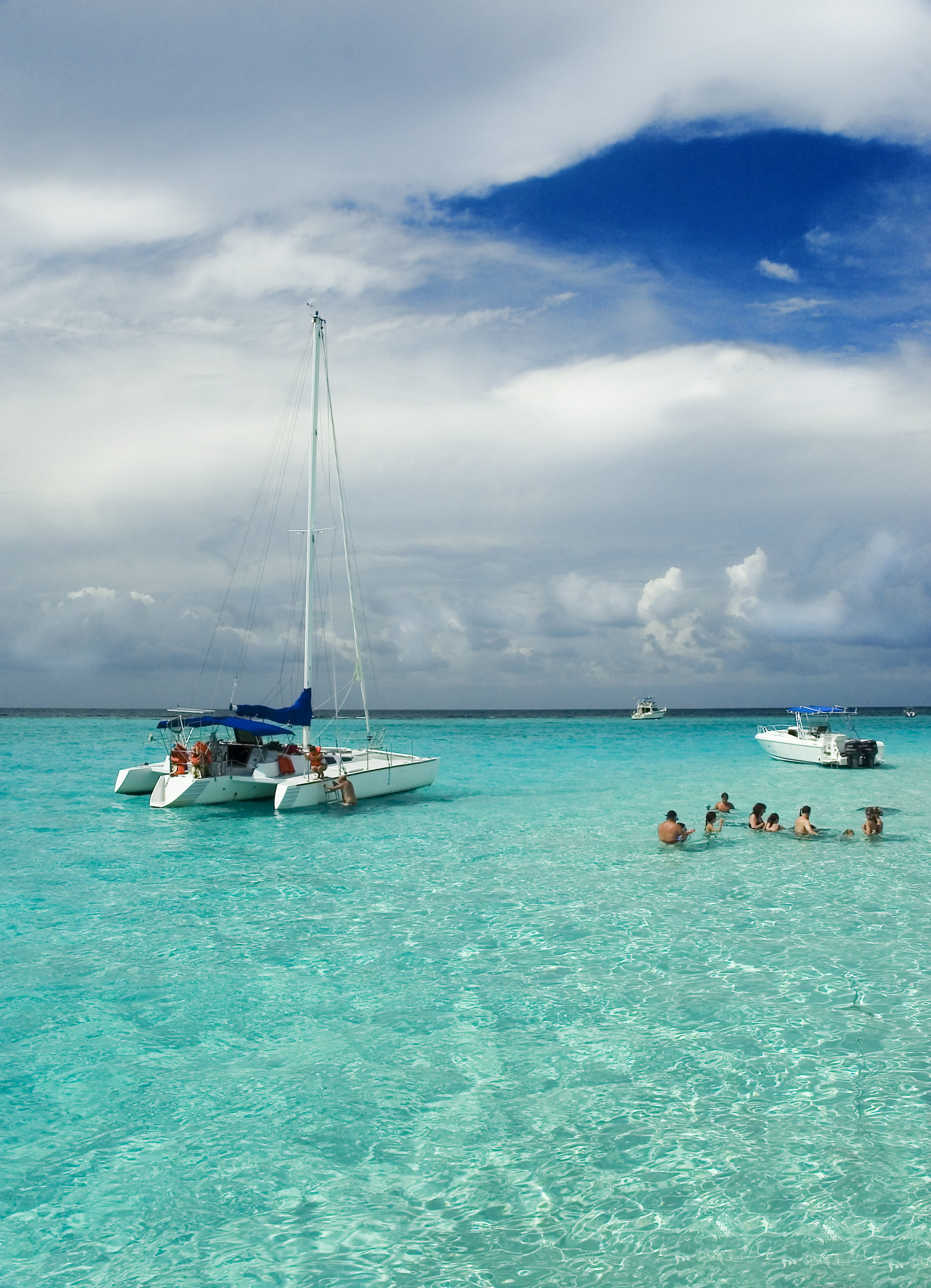 City Mexico Trip Ideas Tulum sky water Boat outdoor Sea coastal and oceanic landforms body of water Ocean cloud caribbean azure shore tropics vacation Island Lagoon wave Beach Coast bay horizon calm wind wave tourism inlet tree blue day