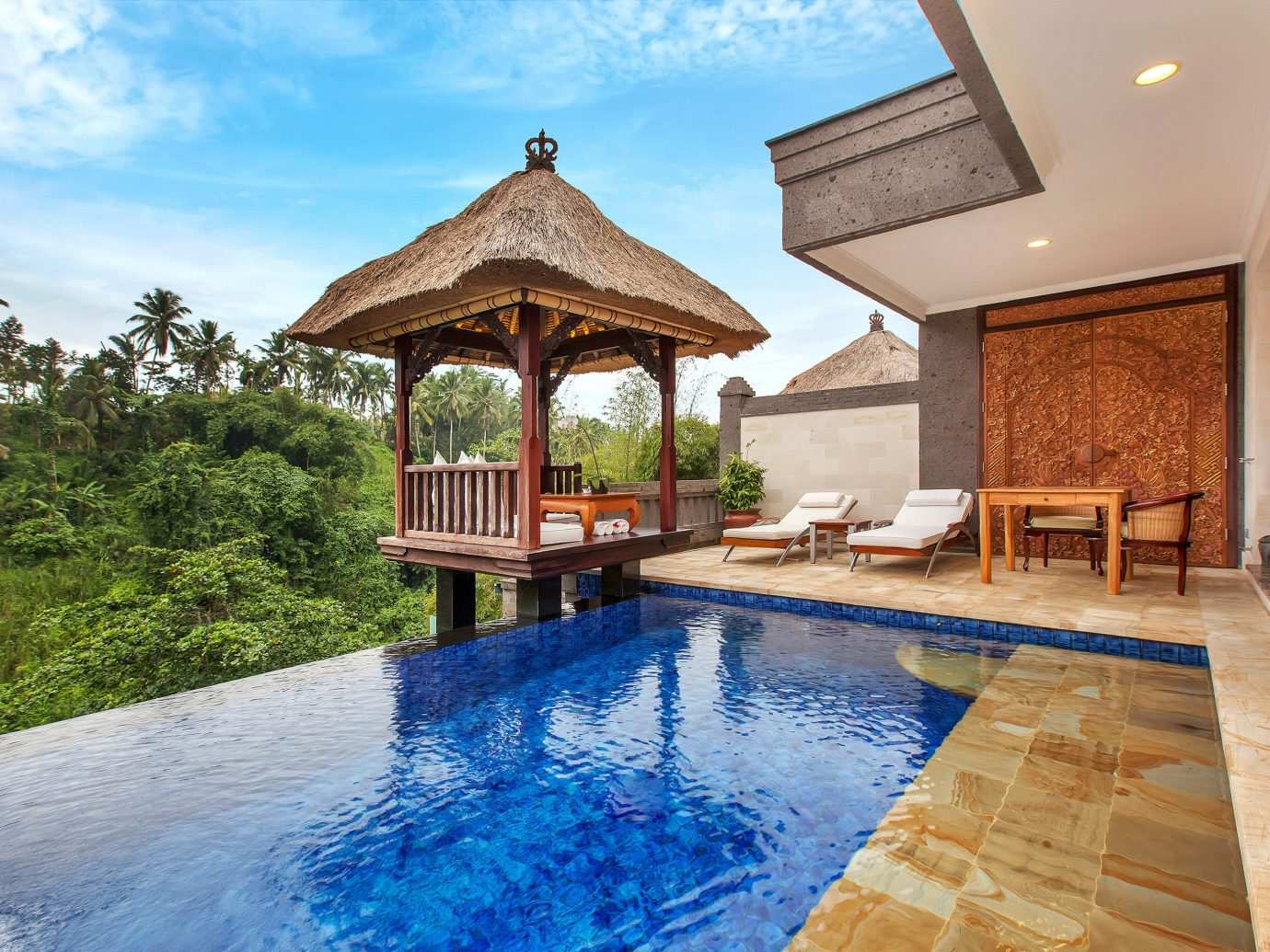 Elegant Hotels Luxury Pool Tropical outdoor building swimming pool property estate Resort Villa vacation real estate home backyard mansion cottage hacienda stone Island