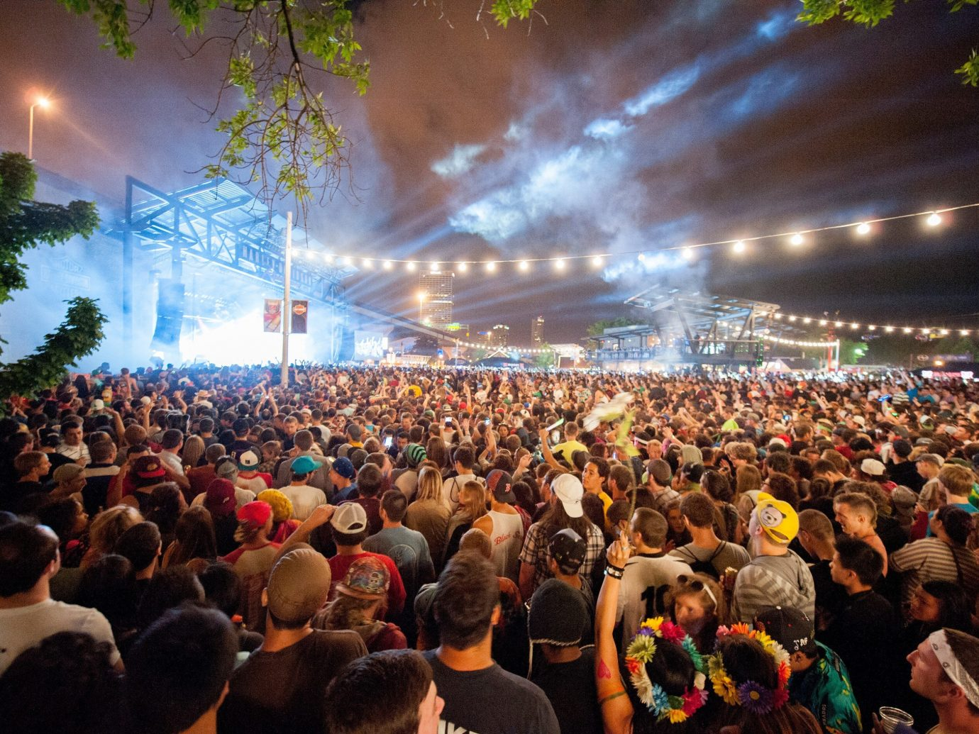 Arts + Culture person crowd tree people audience large rock concert performance stage concert festival group huge event