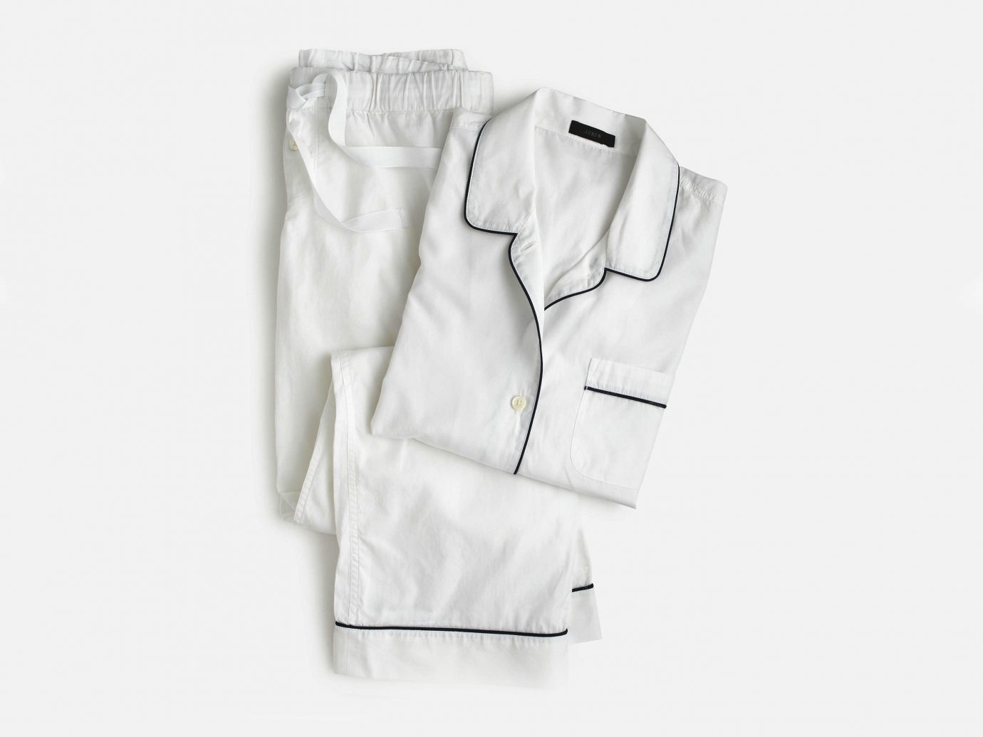 Health + Wellness Travel Tips clothing white sleeve dress shirt pocket outerwear tuxedo formal wear leather textile jacket collar shirt suit