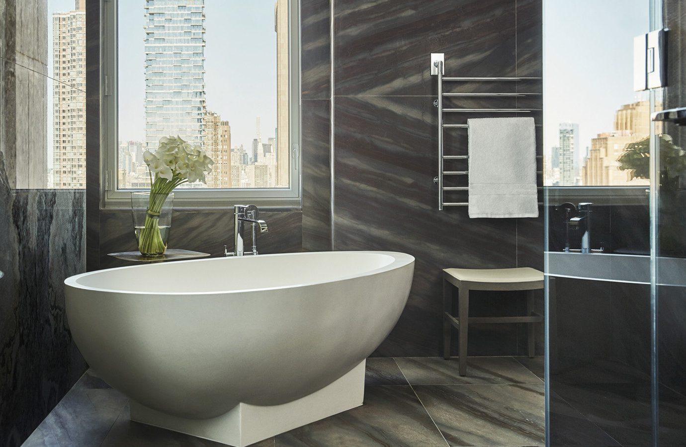 Hotels indoor floor window room bathtub bathroom plumbing fixture bidet interior design flooring tile tub tiled