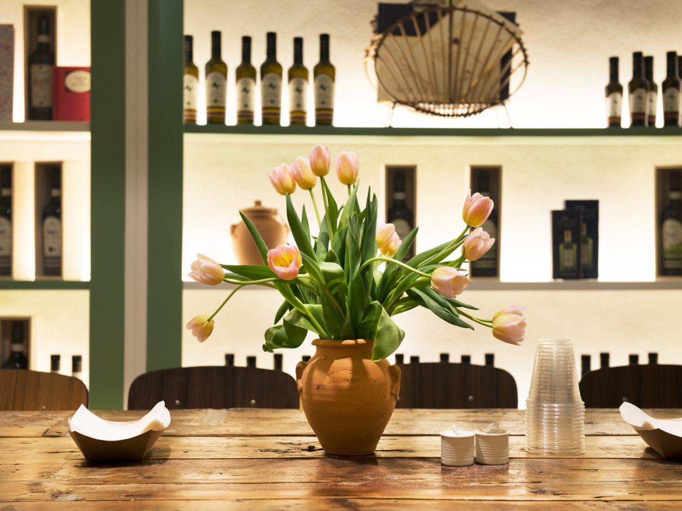 Arts + Culture indoor room dining room floristry flower arranging wall home shelf interior design wood living room Design lighting floral design furniture flower table modern art several