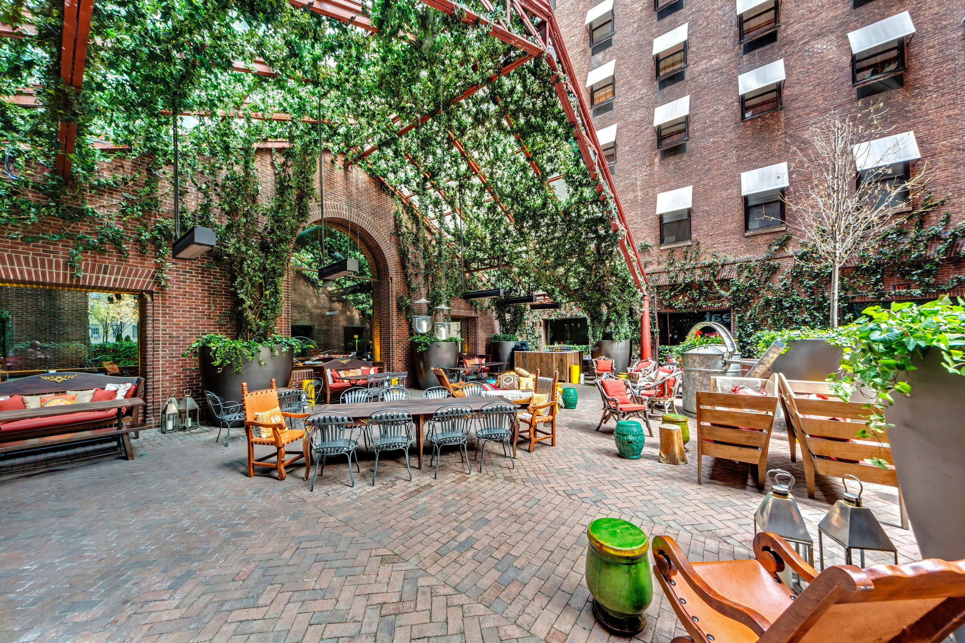 Budget City Dining Drink Eat Hotels Modern Outdoors Travel Tips Trip Ideas outdoor Courtyard Resort backyard estate yard outdoor structure plaza restaurant Garden