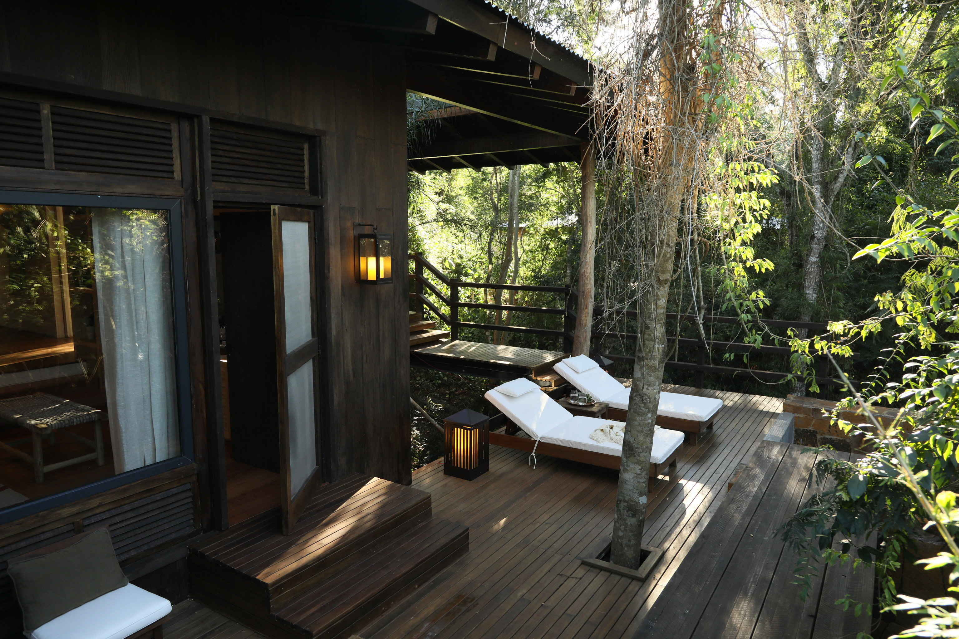 Boutique Hotels Hotels Luxury Travel Outdoors + Adventure tree building property house Architecture plant cottage porch outdoor structure home real estate backyard interior design window Deck wood furniture area stone