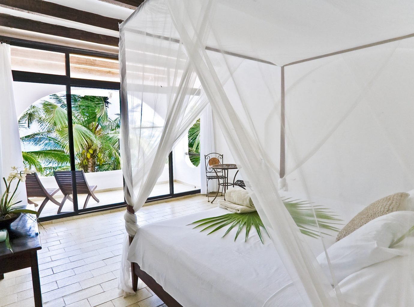 Bedroom Island Luxury Mexico Trip Ideas Waterfront Weekend Getaways indoor plant property room window interior design estate real estate Villa furniture