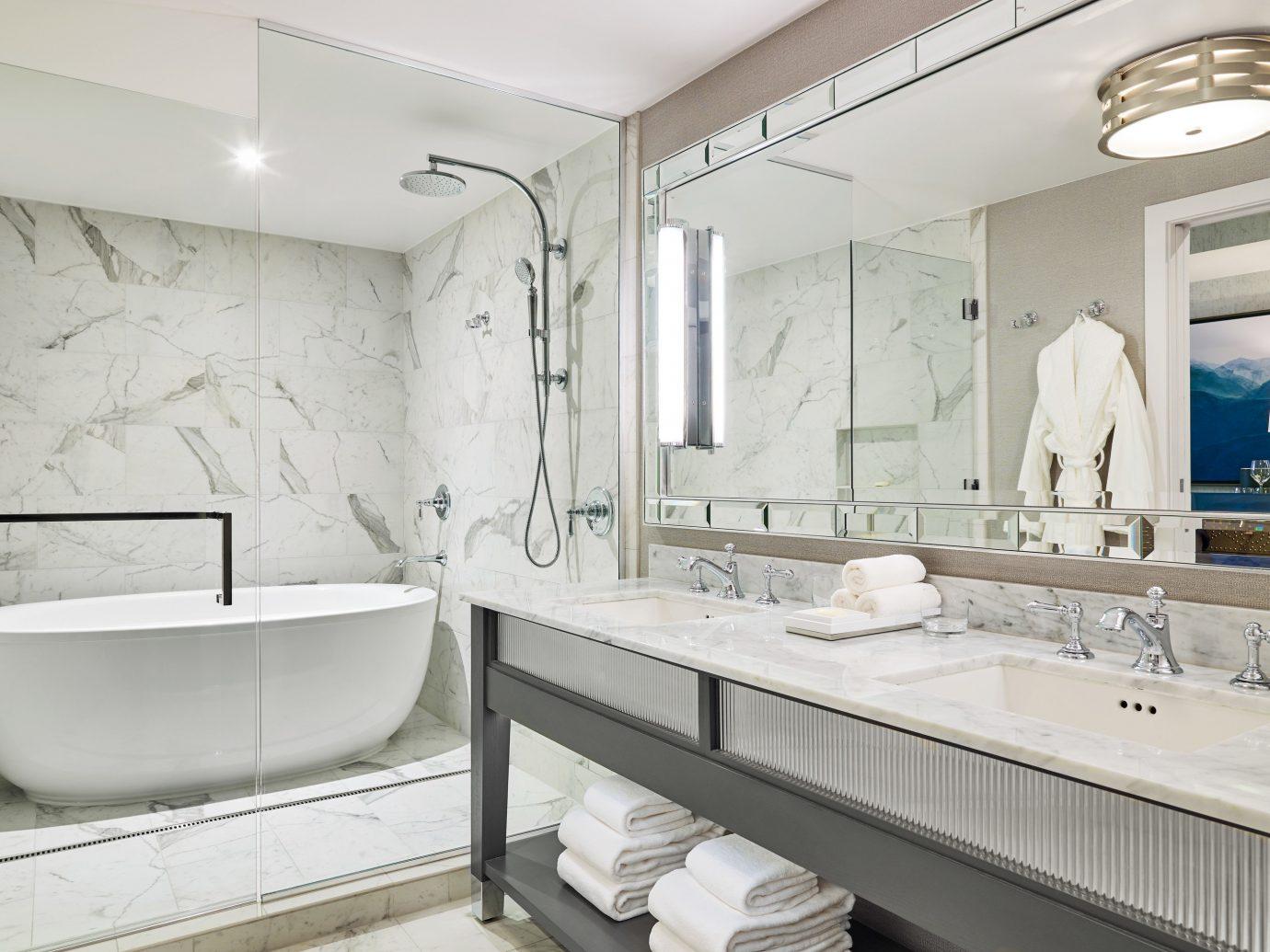 Boutique Hotels Hotels Outdoors + Adventure Winter bathroom indoor wall mirror sink room interior design tap product design floor plumbing fixture interior designer tub Bath bathtub