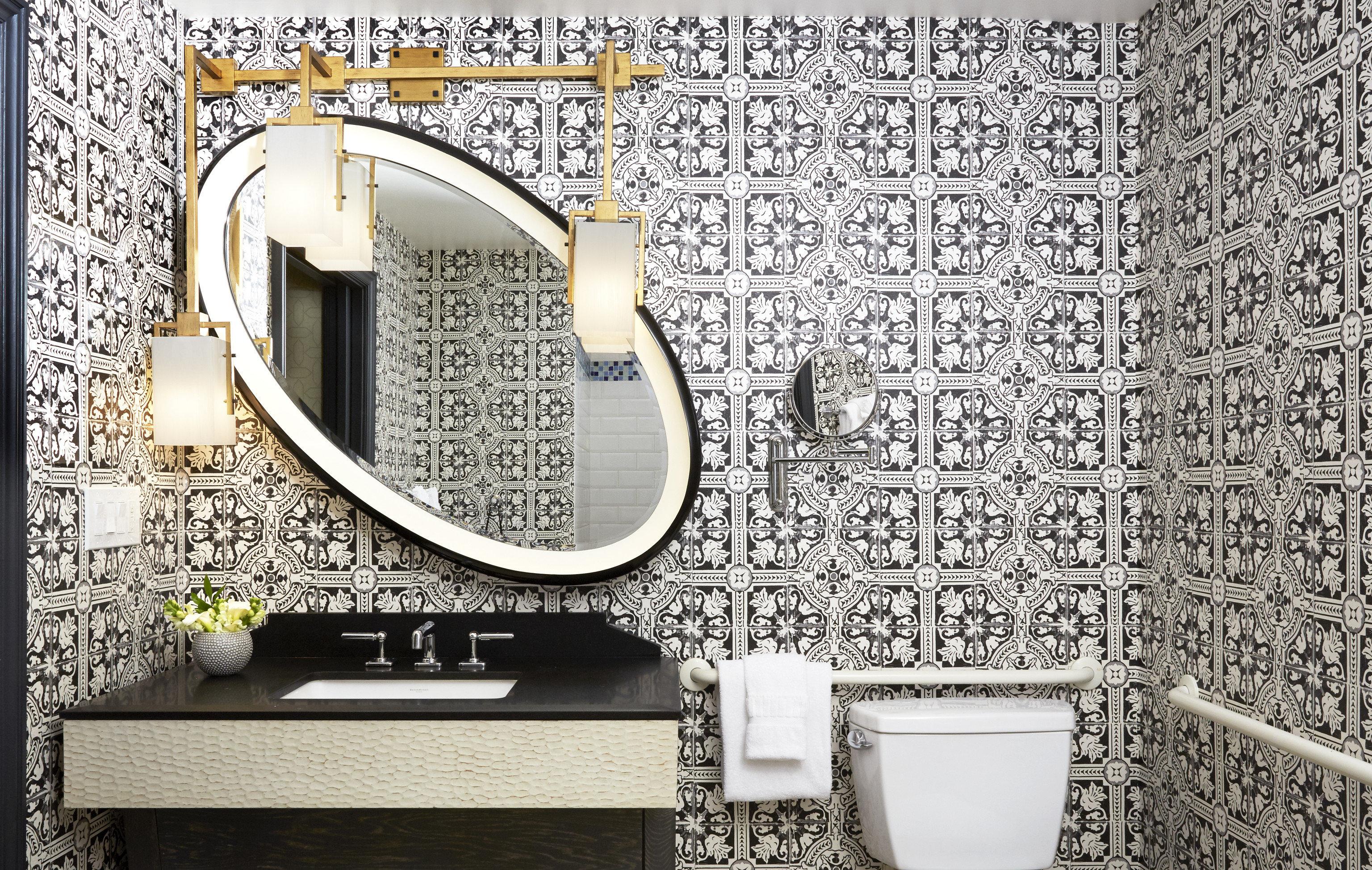Hotels bathroom toilet text indoor font wall Design brand interior design wallpaper pattern tiled