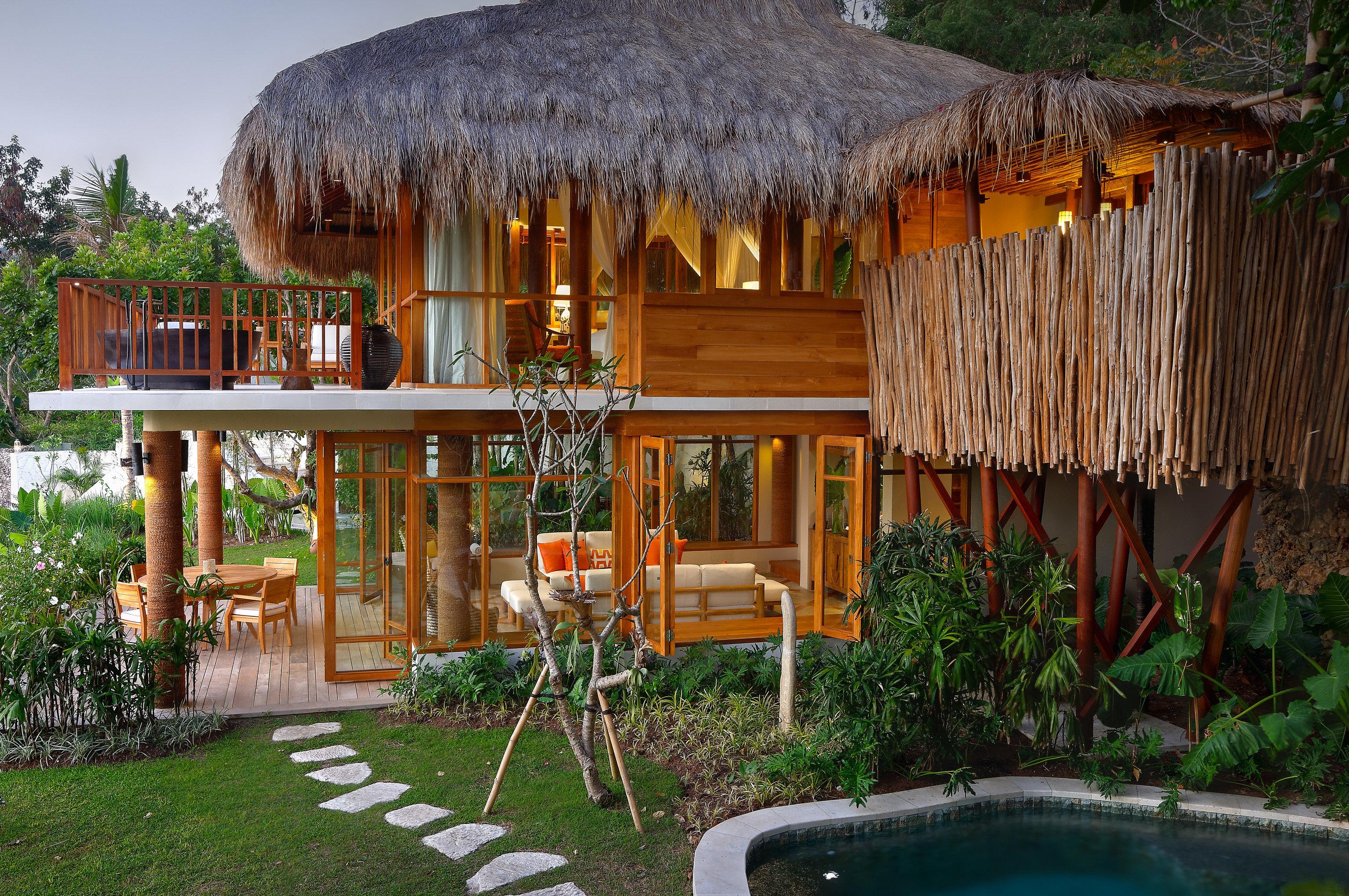Beach Islands Luxury Travel Trip Ideas outdoor tree grass building house Resort estate hut backyard eco hotel Villa cottage lawn Jungle outdoor structure hacienda area