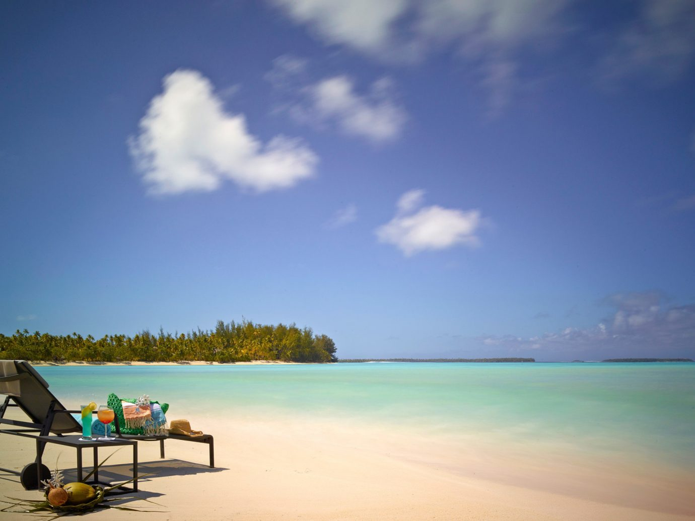 All-Inclusive Resorts Beach clear water Greenery Hotels Island Islands isolation lounge chairs Luxury Travel Ocean palm trees people relaxation relaxing remote serene sunbathing Tropical turquoise white sands sky outdoor water Sea body of water shore horizon vacation bay caribbean Coast Lagoon clouds sandy day