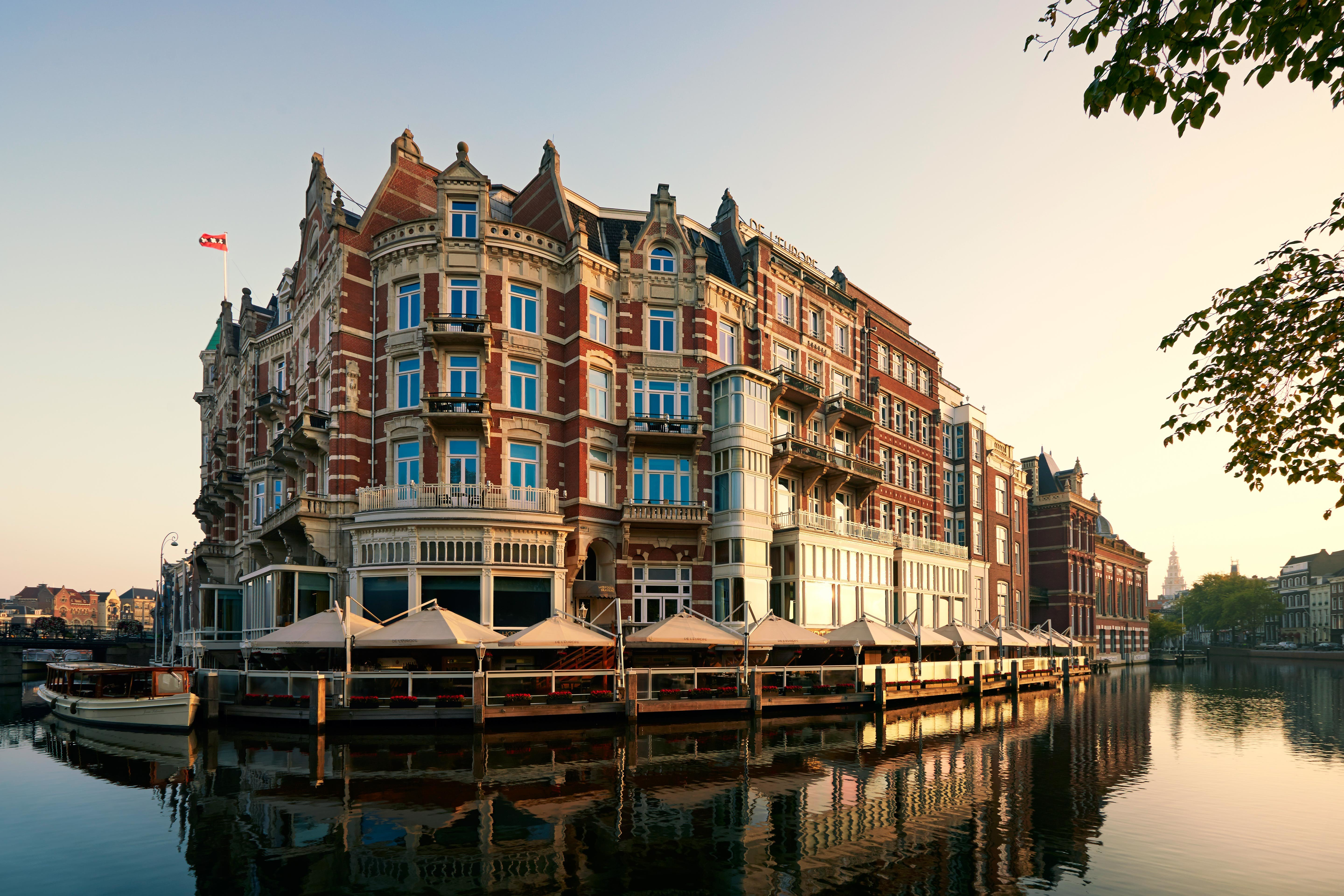 Amsterdam Architecture Buildings City Elegant Historic Hotels Lake The Netherlands Waterfront water outdoor sky Boat scene landmark reflection waterway River vehicle Harbor Canal tourism cityscape