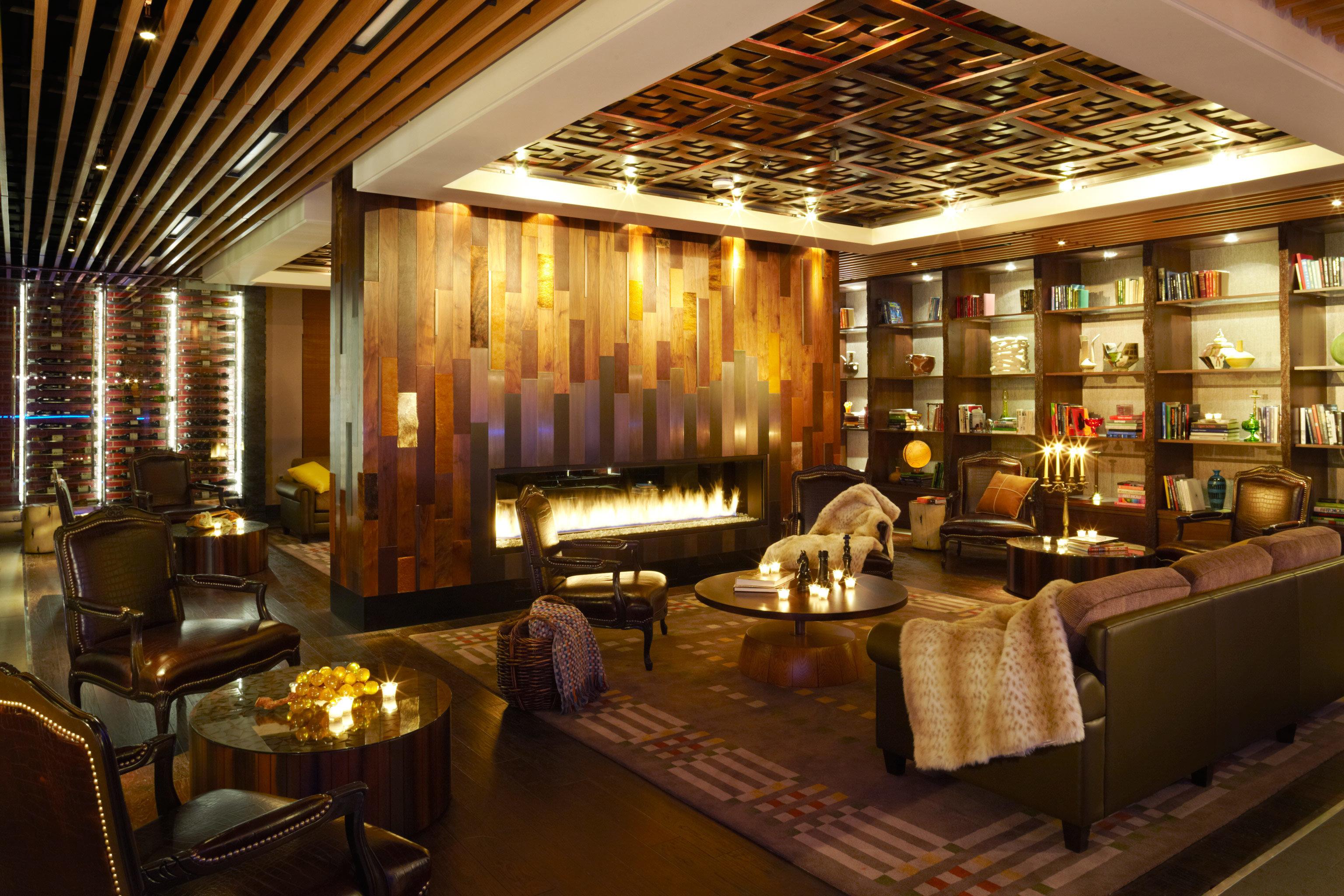 Hotels Luxury Travel Mountains + Skiing indoor ceiling room floor Living window Lobby estate interior design Bar furniture restaurant recreation room function hall living room area several
