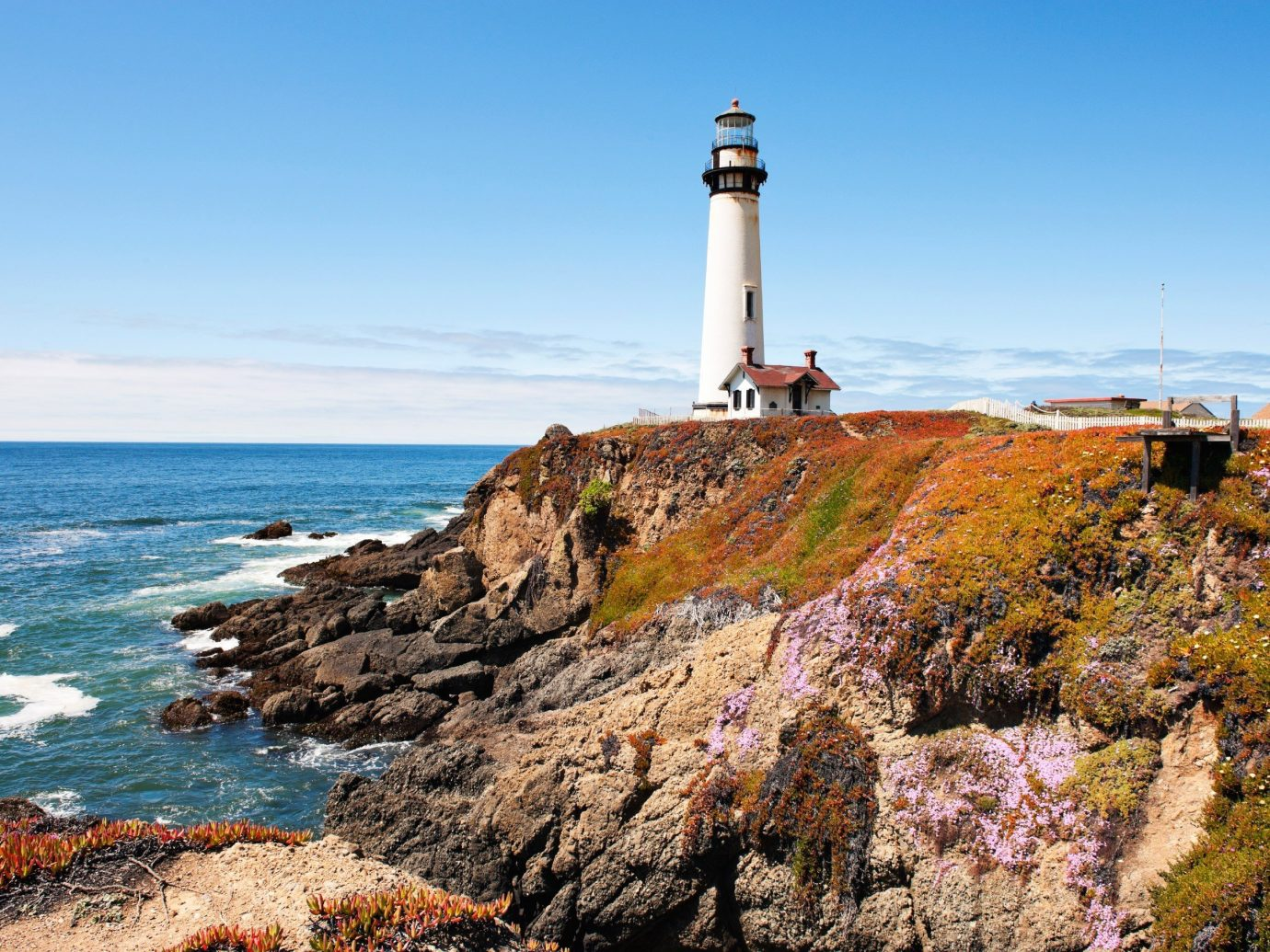 Trip Ideas sky outdoor rock water lighthouse tower Coast rocky mountain Sea shore cliff Ocean Nature cape cove terrain bay overlooking hillside Island