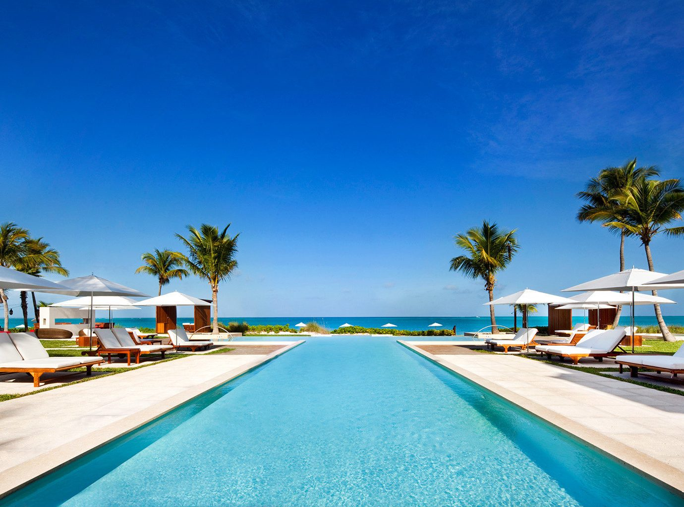 Beachfront Grounds Hotels Luxury Pool sky outdoor leisure swimming pool Beach vacation Resort Sea caribbean Ocean way bay marina estate Coast Lagoon dock colorful lined highway