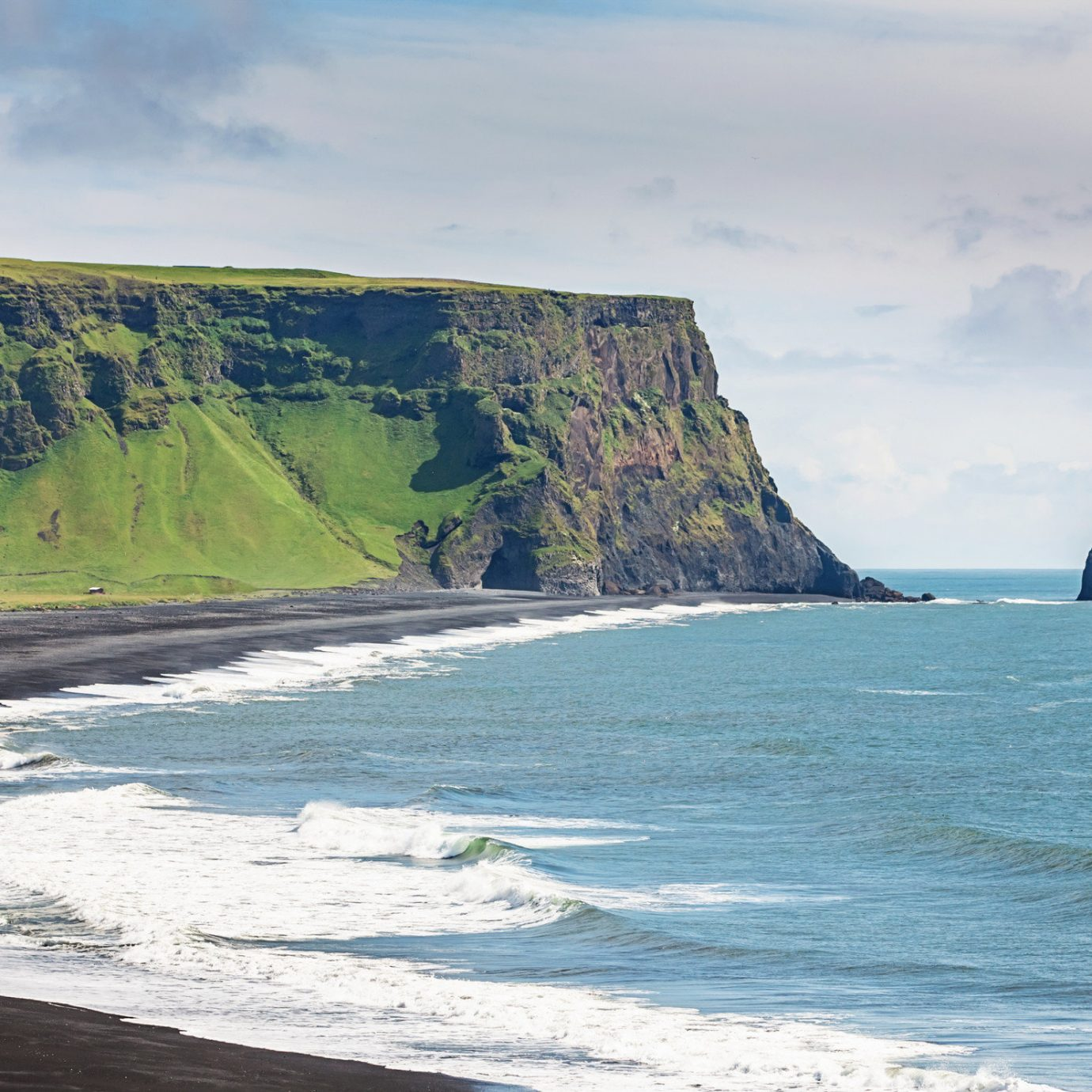 Iceland Outdoors + Adventure Road Trips outdoor sky water Nature Coast cliff Sea geographical feature mountain shore landform Ocean body of water wave wind wave vacation bay Beach terrain rock cape cove Island fjord islet material promontory day