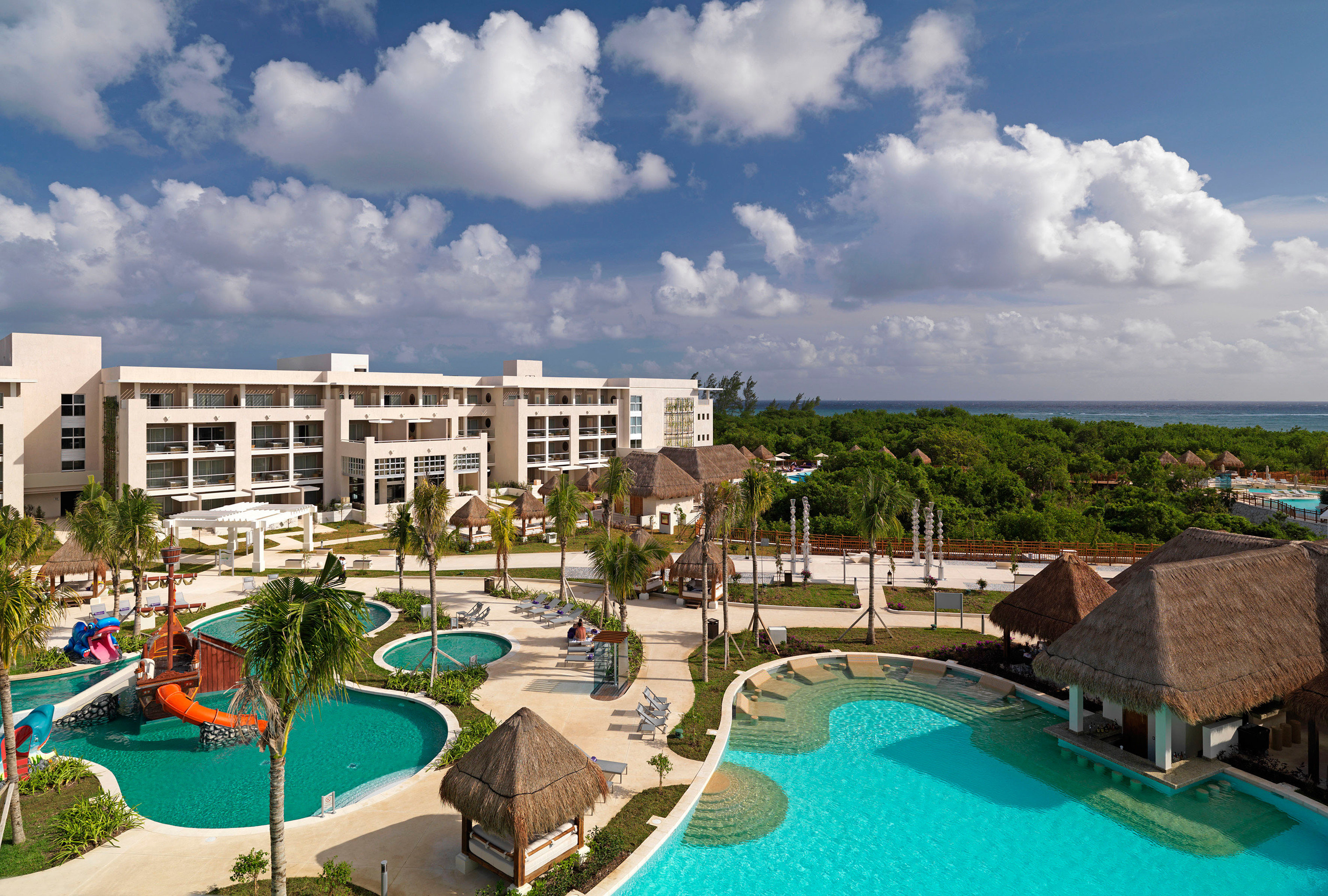 All-Inclusive Resorts Family Family Travel Hotels Pool sky outdoor leisure property Resort vacation estate swimming pool marina condominium real estate Sea bay blue day