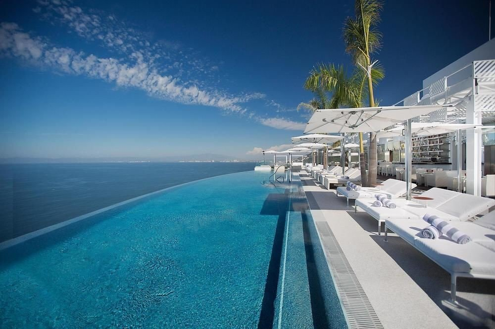 All-Inclusive Resorts Hotels outdoor sky marina Ocean Sea vacation vehicle caribbean passenger ship dock yacht Resort bay