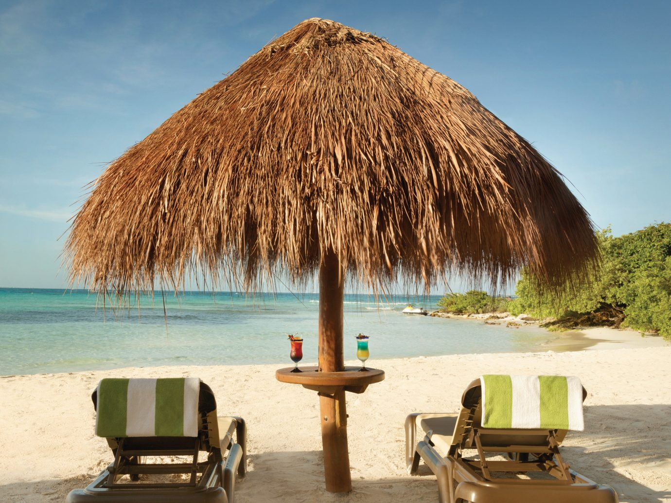 All-Inclusive Resorts Family Travel Hotels Romance Travel Tips sky outdoor ground water Beach body of water tree Sea vacation Ocean arecales Coast Nature shore hut bay Island Lagoon day sandy