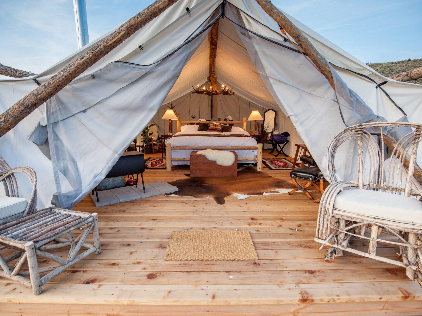 Glamping Outdoors + Adventure Weekend Getaways tent wooden cottage outdoor structure hut estate Resort Villa
