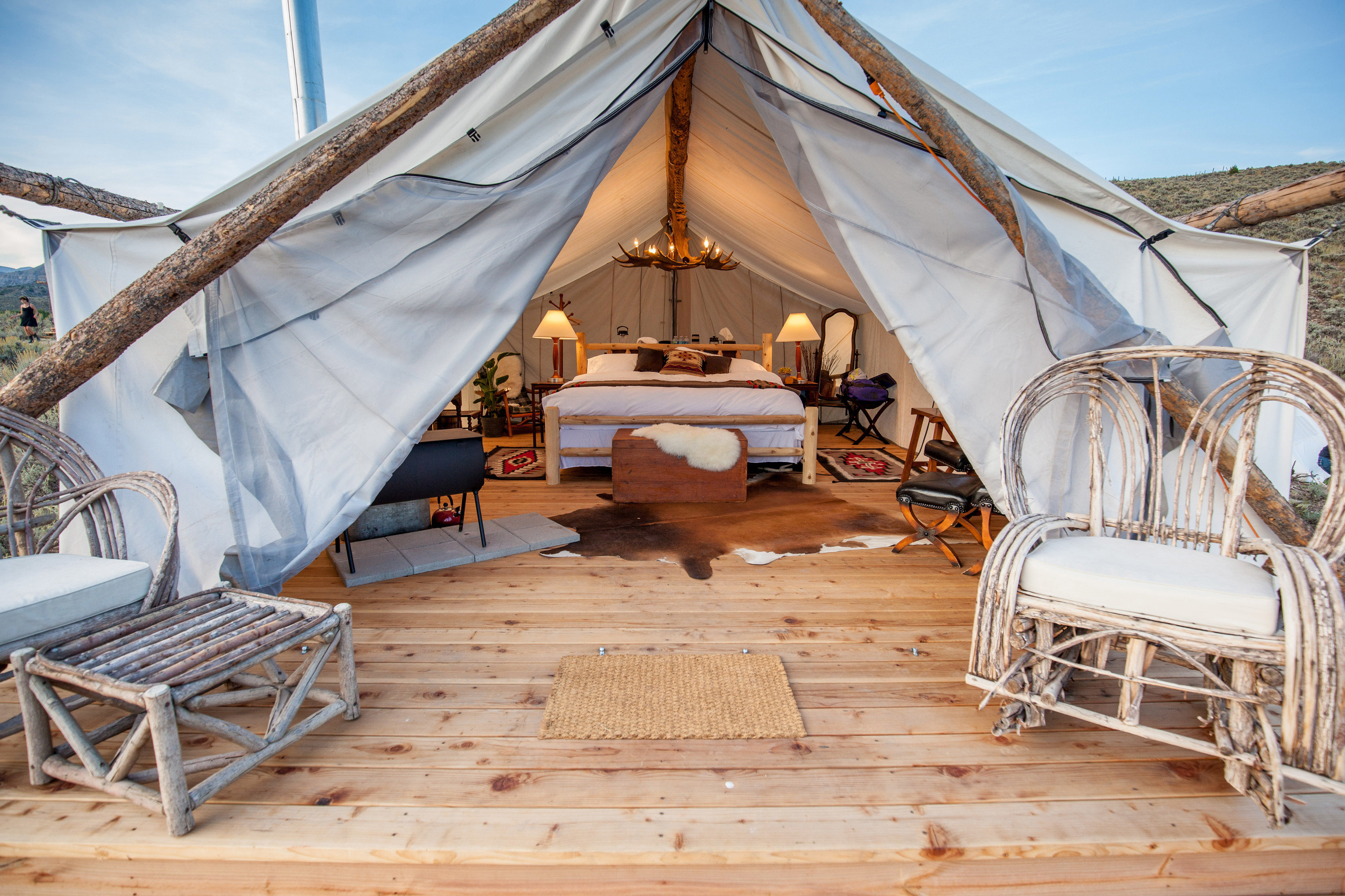Glamping Outdoors + Adventure Weekend Getaways tent wooden cottage outdoor structure hut estate Resort Villa