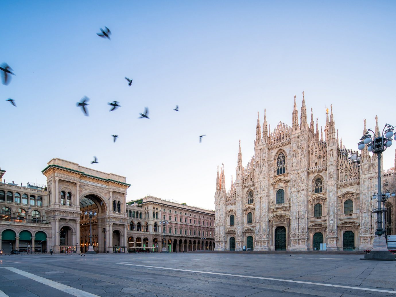 Arts + Culture Italy Milan Trip Ideas sky landmark town square Town plaza City urban area building metropolis daytime metropolitan area palace facade tourist attraction Downtown street tree