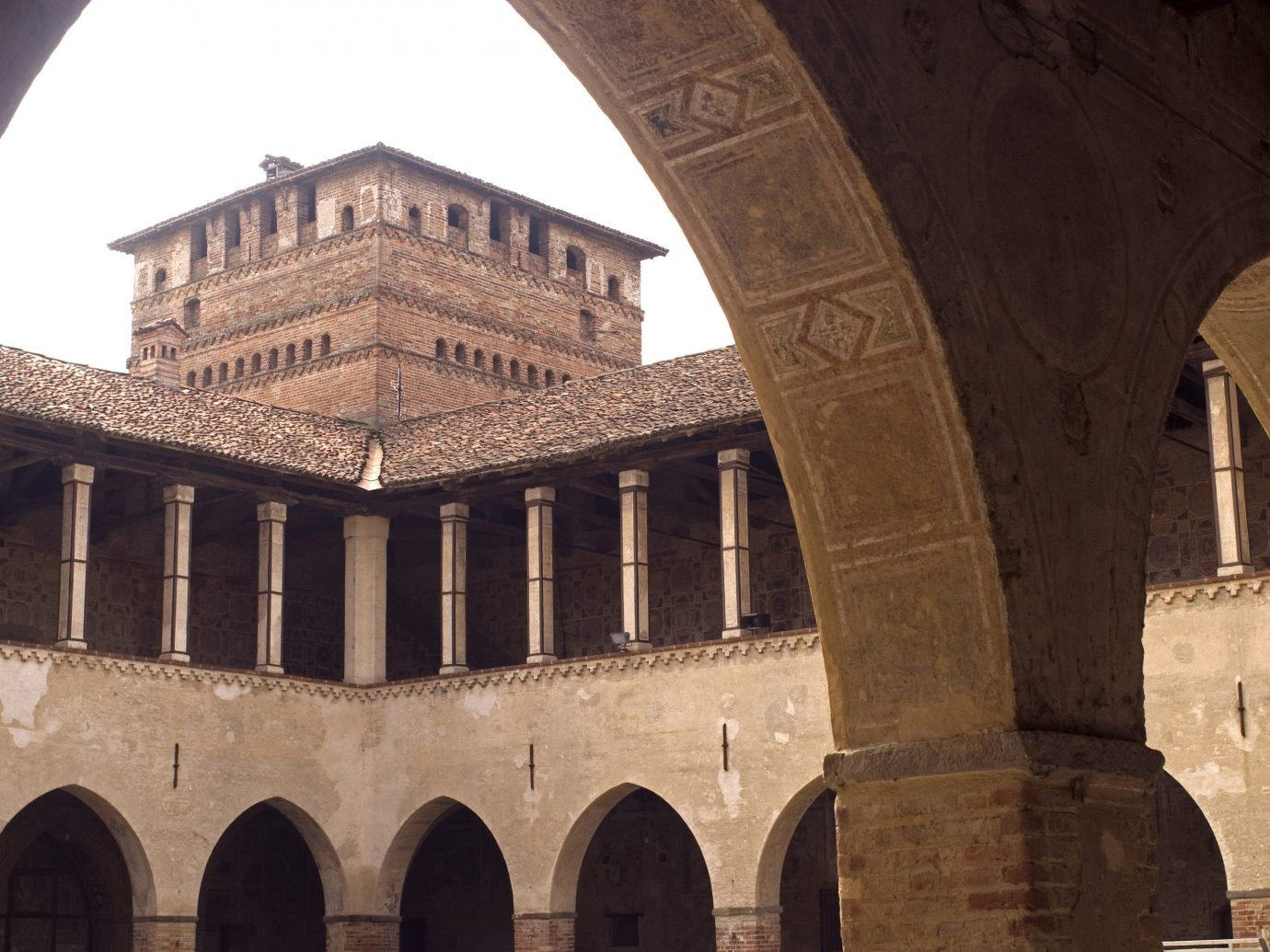 Arts + Culture Italy Milan Trip Ideas arch historic site landmark column building medieval architecture history ancient history arcade ancient roman architecture basilica facade caravanserai ancient rome fortification sky abbey palace byzantine architecture stock photography window