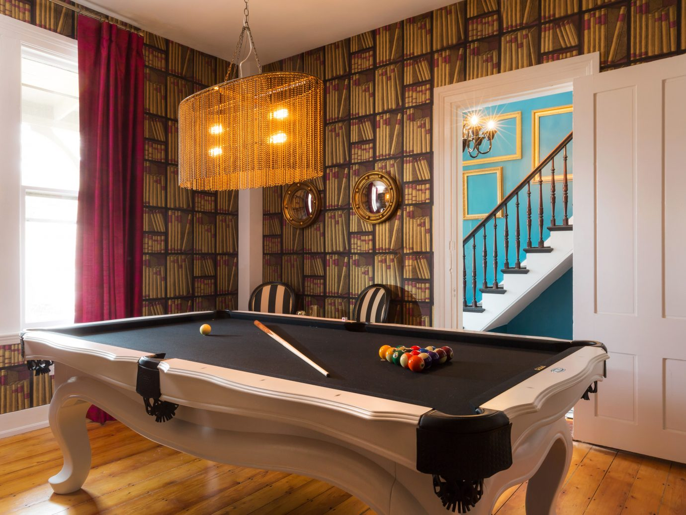Boutique Budget Hip Hotels Living indoor floor recreation room billiard room room billiard table hardwood interior design estate games table basement real estate