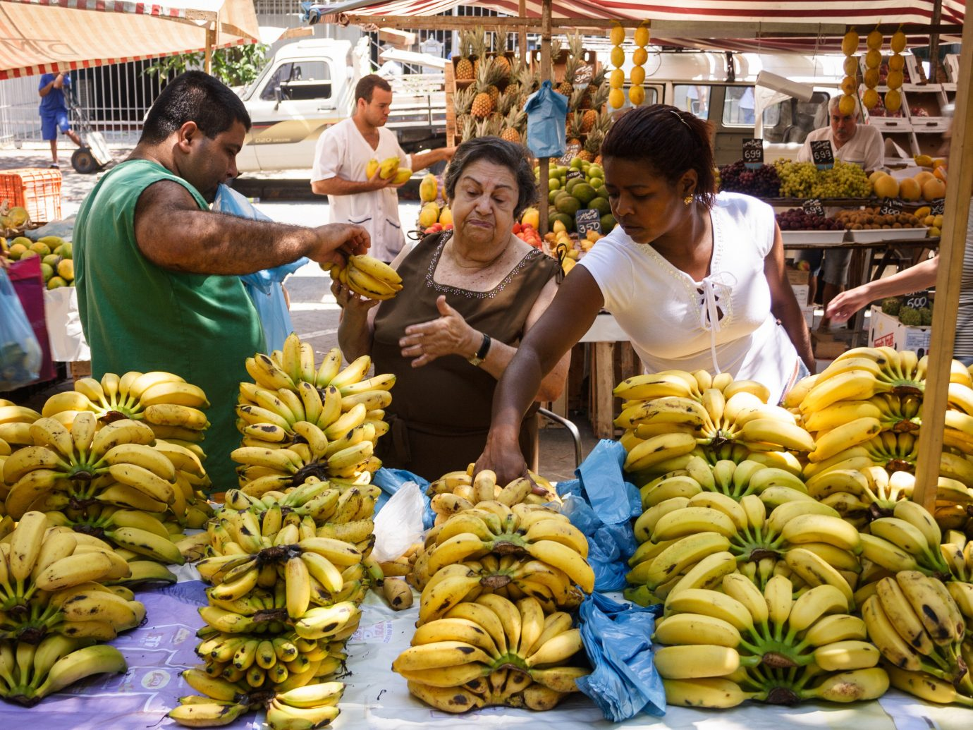 Trip Ideas person marketplace City market public space vendor human settlement food produce banana carving flower sale several fresh
