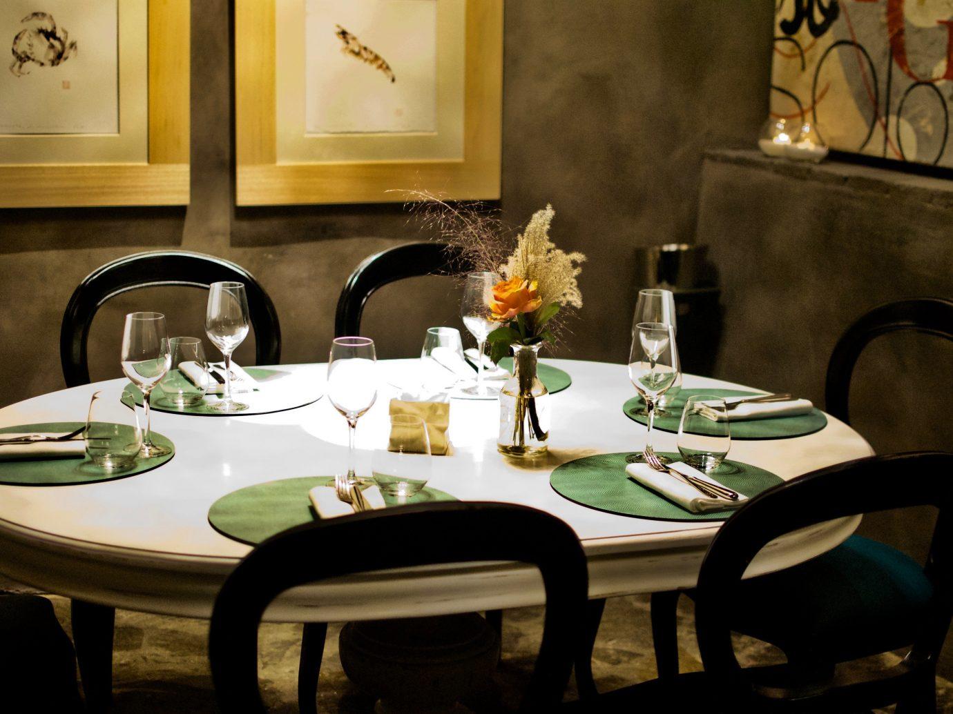 Arts + Culture table indoor dining room room restaurant meal interior design home estate dinner living room set