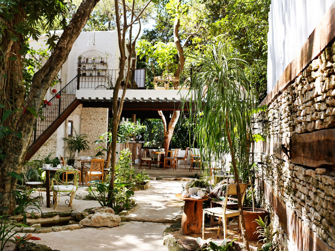 Boutique Budget Dining Drink Eat Garden Grounds Hotels Romance Rustic Trip Ideas Tropical tree outdoor Resort vacation Village tourism estate restaurant Courtyard cottage area stone furniture several