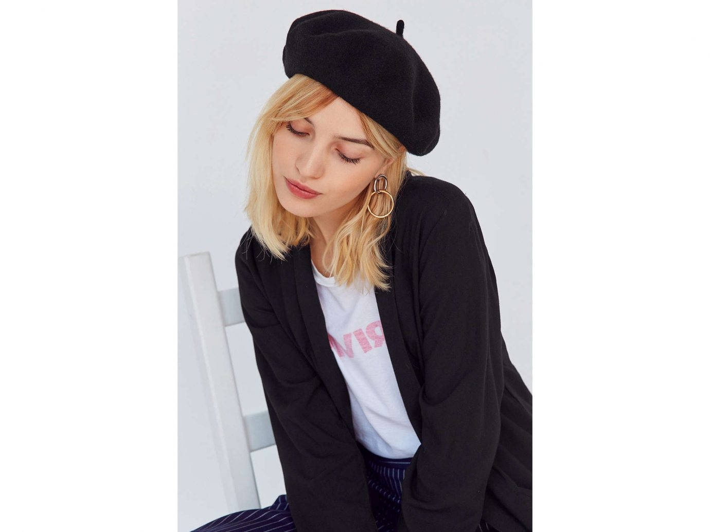 Style + Design Travel Shop person clothing woman wearing cap headgear beanie suit knit cap hat jacket sleeve dressed posing