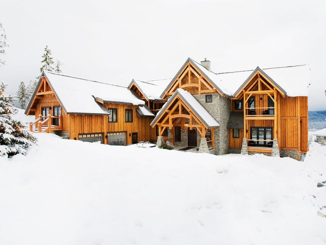 Hotels Luxury Travel Mountains + Skiing Trip Ideas snow outdoor sky Winter weather house building Town season geological phenomenon home residential area neighbourhood blizzard Village sugar house farm building barn