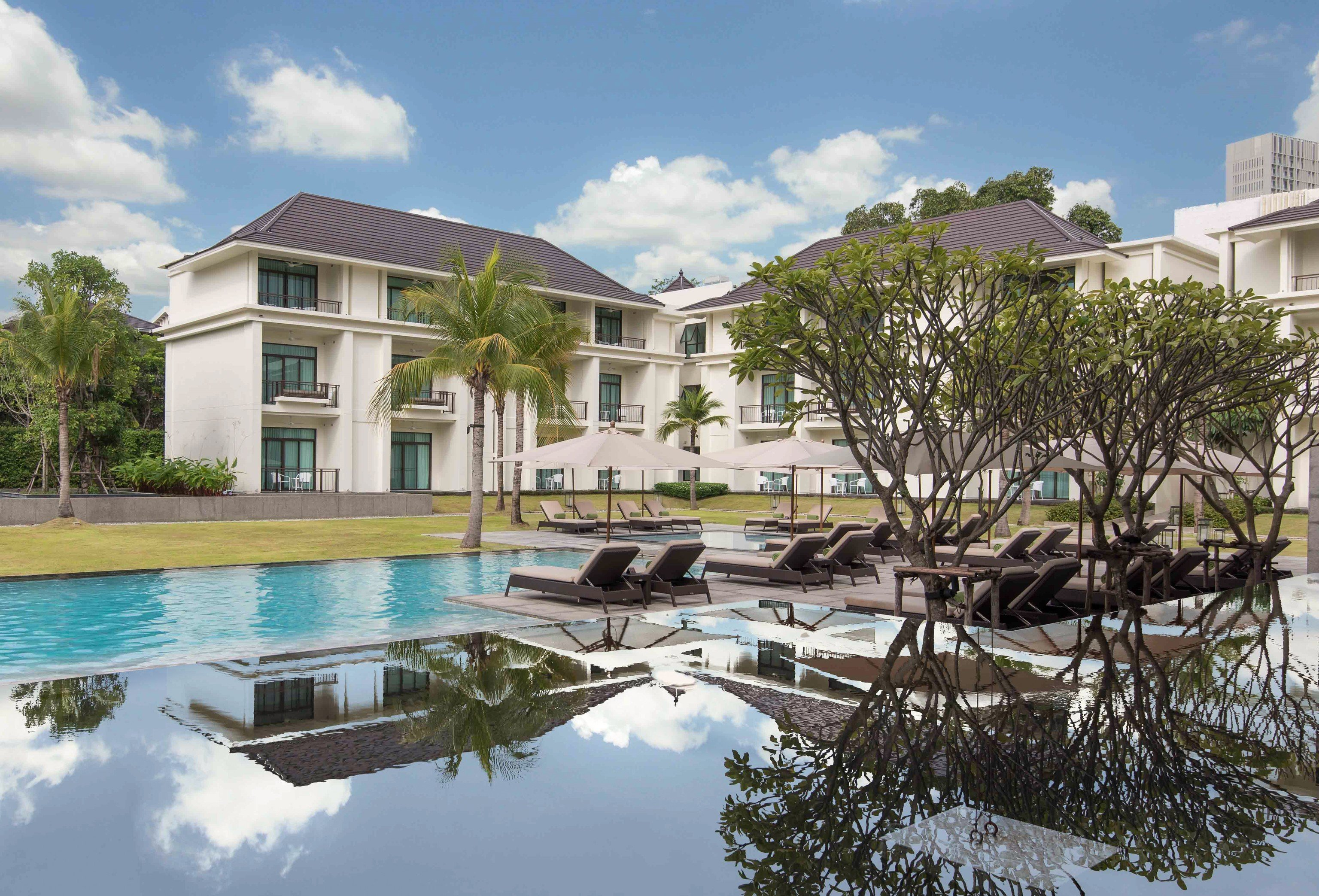 Hotels Romance outdoor water sky Boat house property condominium Resort estate swimming pool home residential area vacation real estate Villa marina mansion dock waterway docked apartment swimming