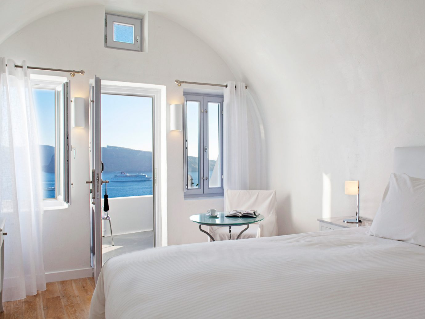 Beachfront Bedroom Greece Hotels Luxury Modern Romance Santorini Scenic views Suite wall indoor bed floor room property white scene cottage interior design estate real estate hotel apartment Villa furniture
