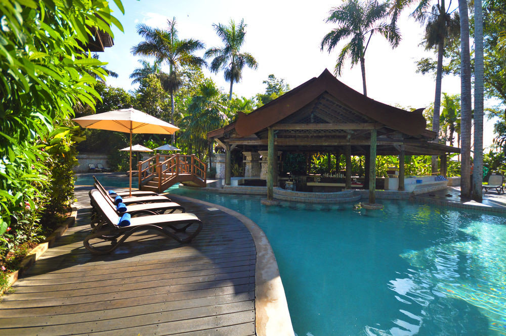 All-Inclusive Resorts Hotels tree outdoor swimming pool chair Resort property leisure estate Pool vacation Villa lined several swimming surrounded