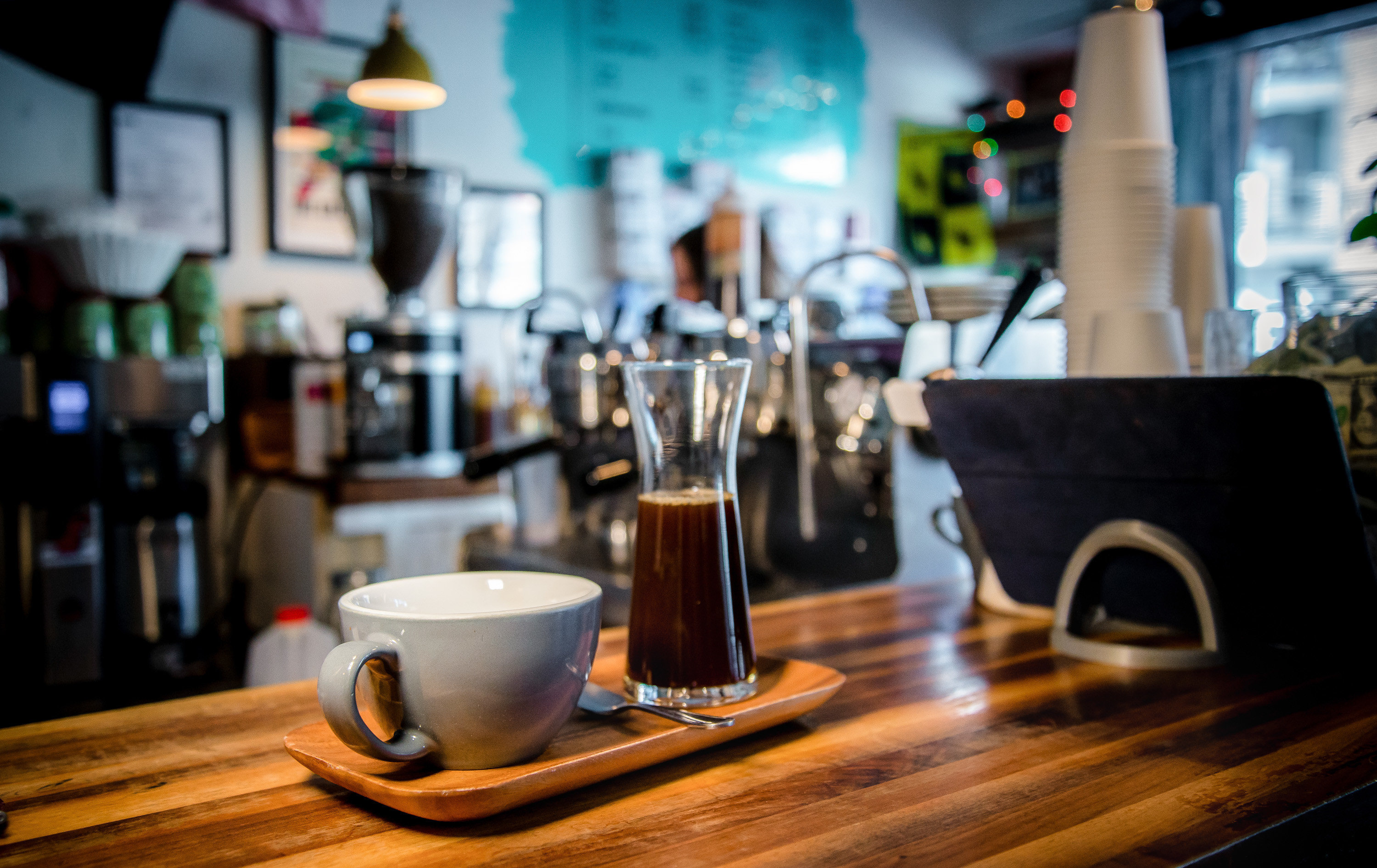 Brooklyn City Food + Drink NYC table indoor Drink cup alcoholic beverage Bar liqueur café beer coffeehouse wooden distilled beverage restaurant counter cluttered