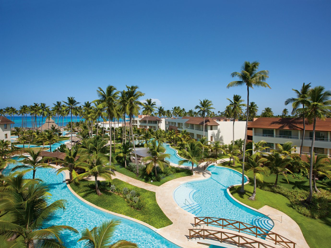 All-Inclusive Resorts Hotels Romance tree sky grass outdoor Resort leisure property swimming pool resort town vacation real estate palm tree estate arecales tourism palm tropics hotel caribbean Pool Lagoon condominium bay colorful Garden plant area
