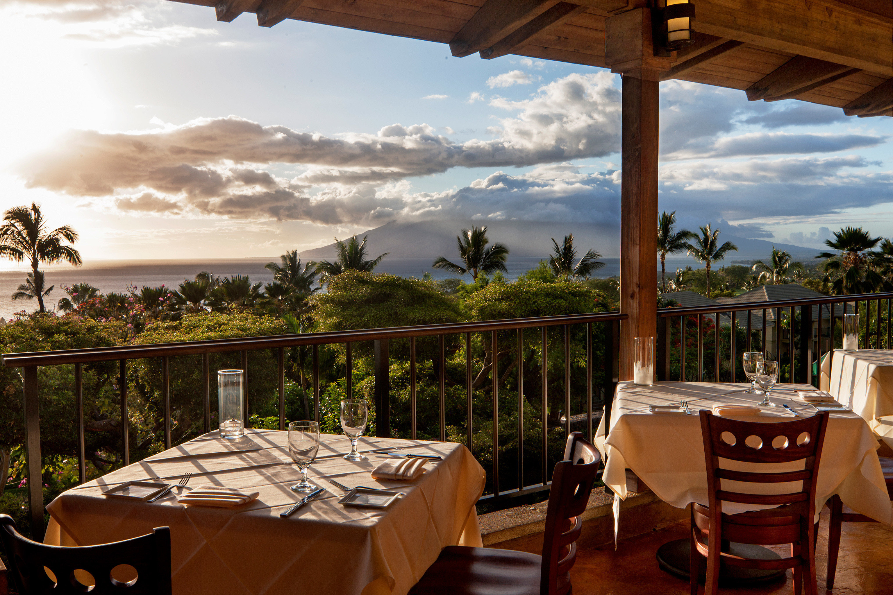 Balcony Bar Beachfront Dining Drink Eat Hotels Island Romance Scenic views Waterfront Wine-Tasting table chair property Resort restaurant estate vacation Villa wooden hacienda meal overlooking area set Deck furniture dining table