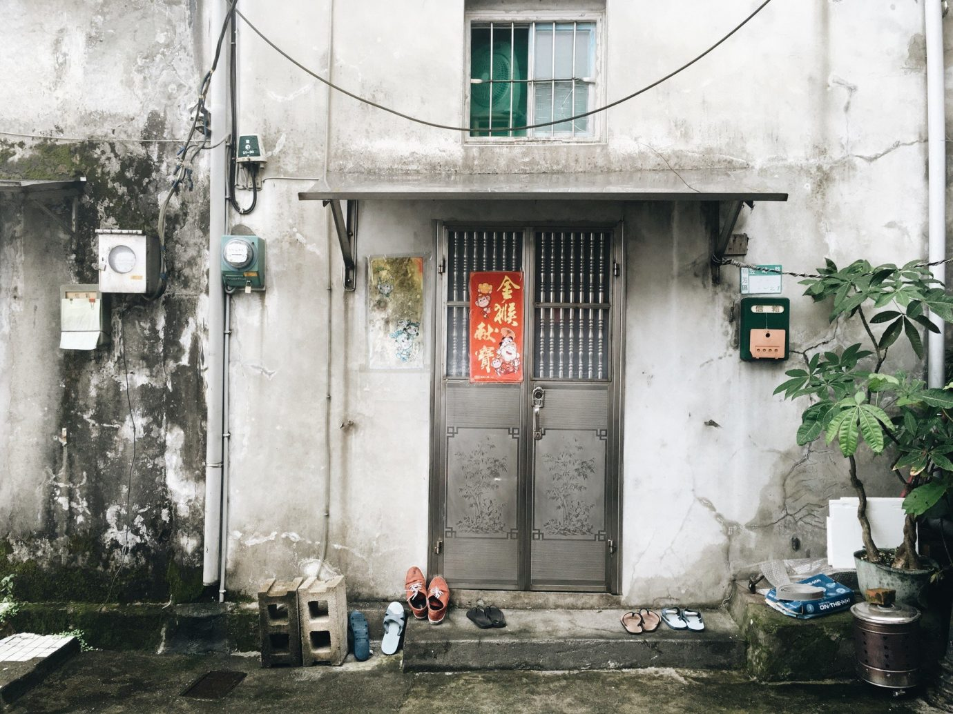 Jetsetter Guides Trip Ideas building outdoor road urban area house neighbourhood street Town alley facade stone dirty scooter