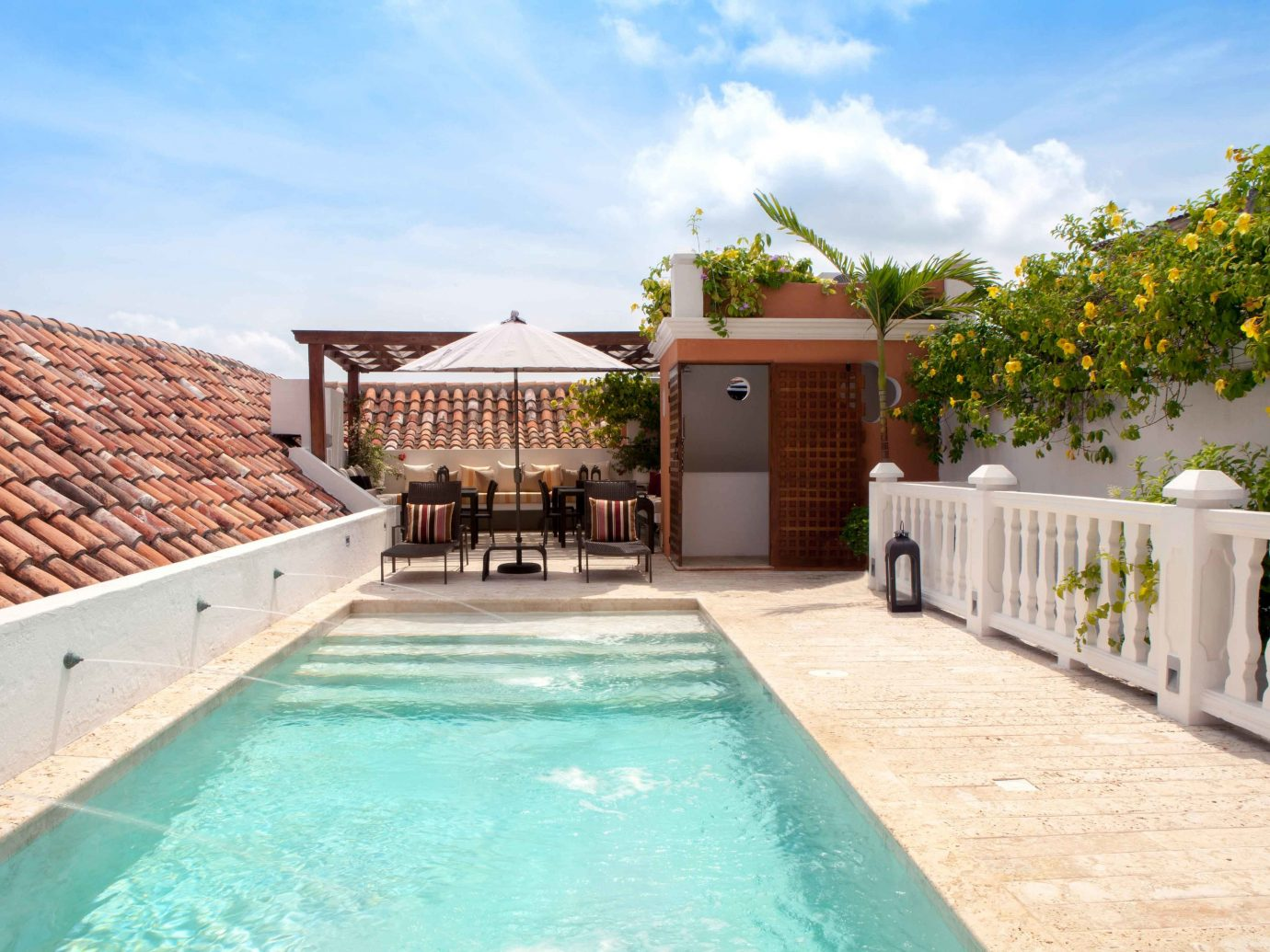 Boutique Hotels Pool Romance sky ground outdoor swimming pool property building estate Villa real estate vacation home backyard Resort cottage condominium mansion hacienda stone cement