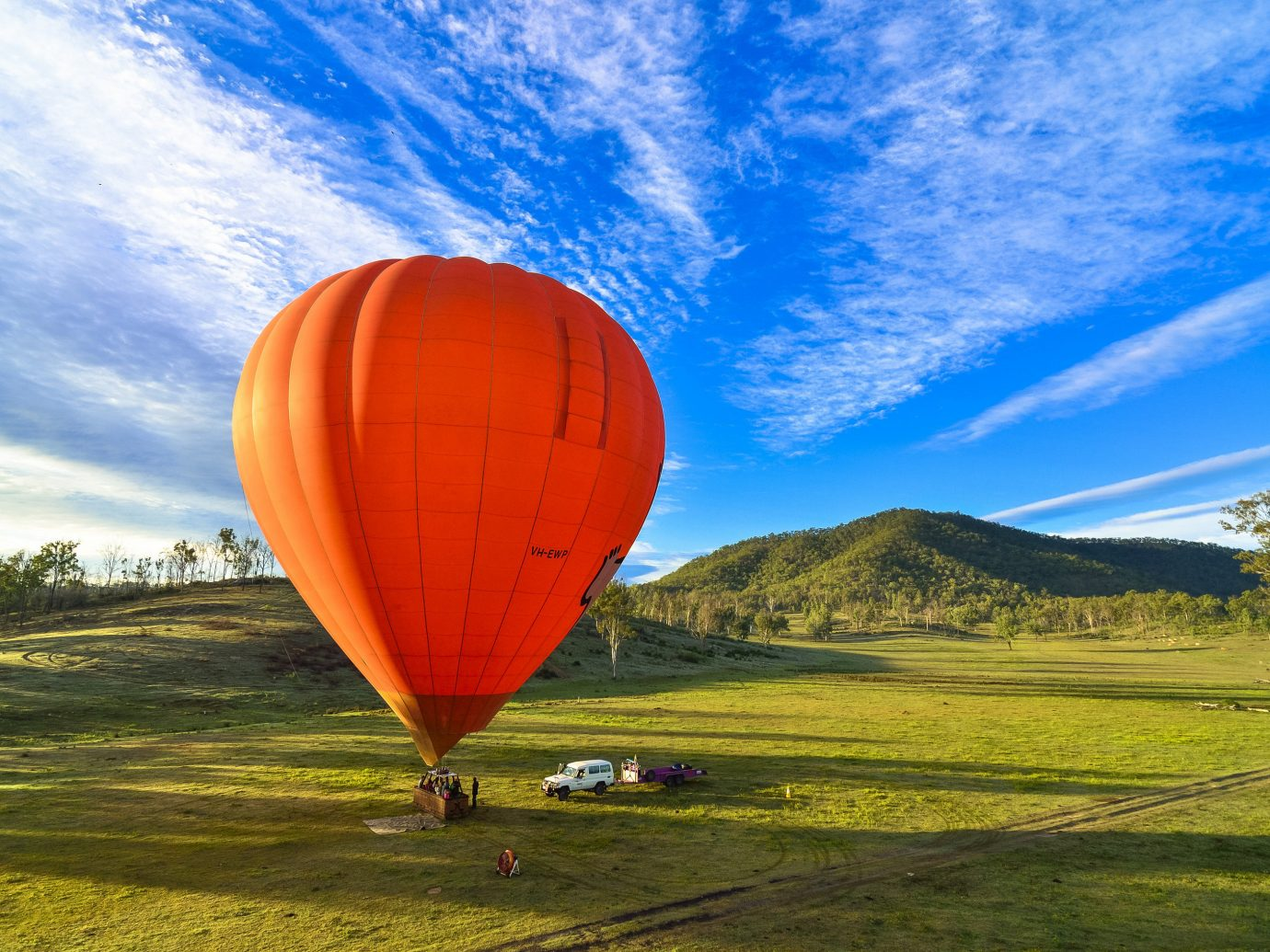 Trip Ideas grass balloon aircraft sky transport outdoor hot air ballooning Hot Air Balloon field mountain vehicle atmosphere of earth orange toy flight grassy lush
