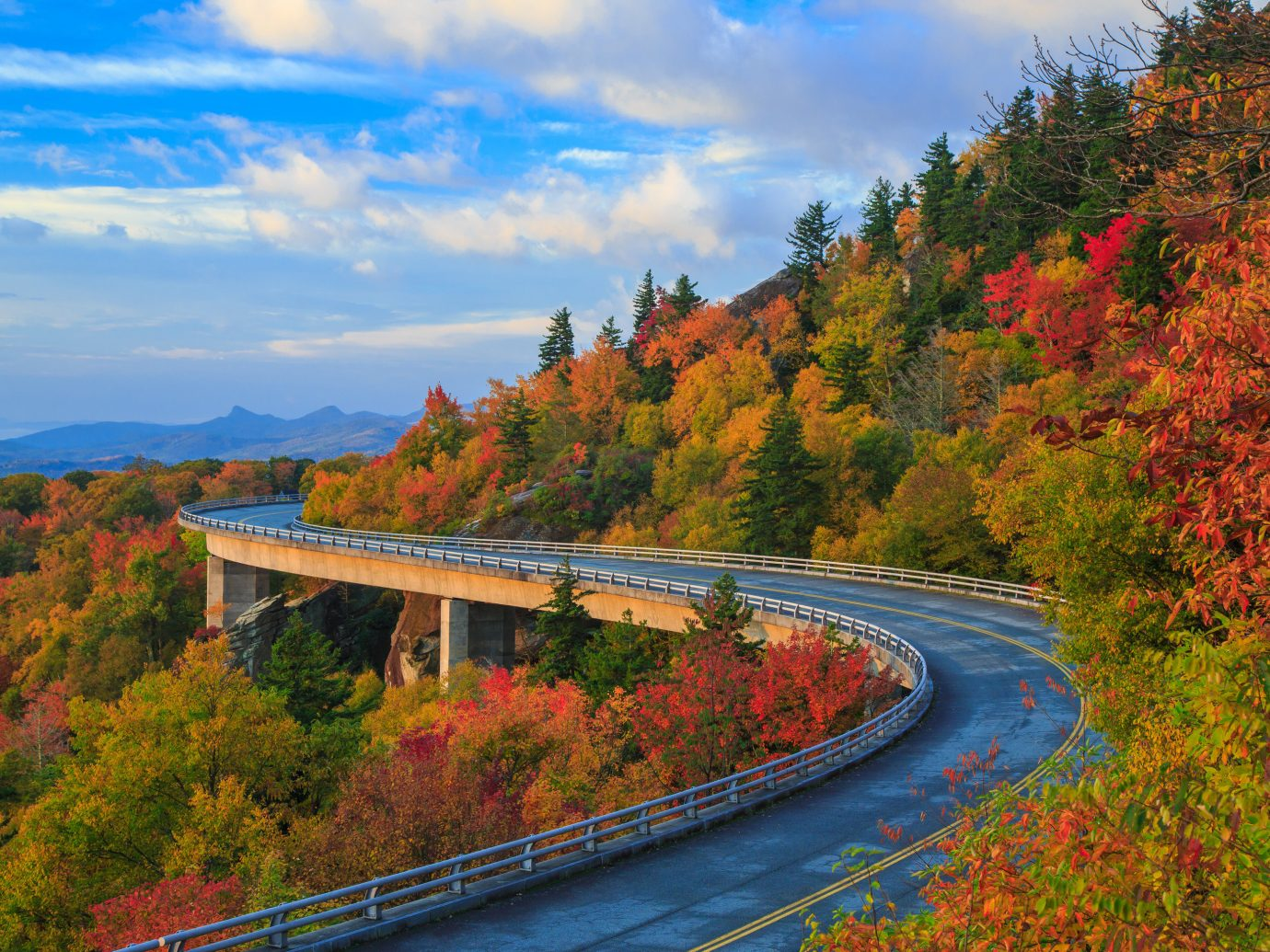 Trip Ideas tree train outdoor sky track mountainous landforms Nature autumn mountain traveling season way Forest leaf plant hill scene River morning woody plant landscape rural area reflection mountain range flower highway meadow lush road wooded surrounded bushes moving beautiful hillside