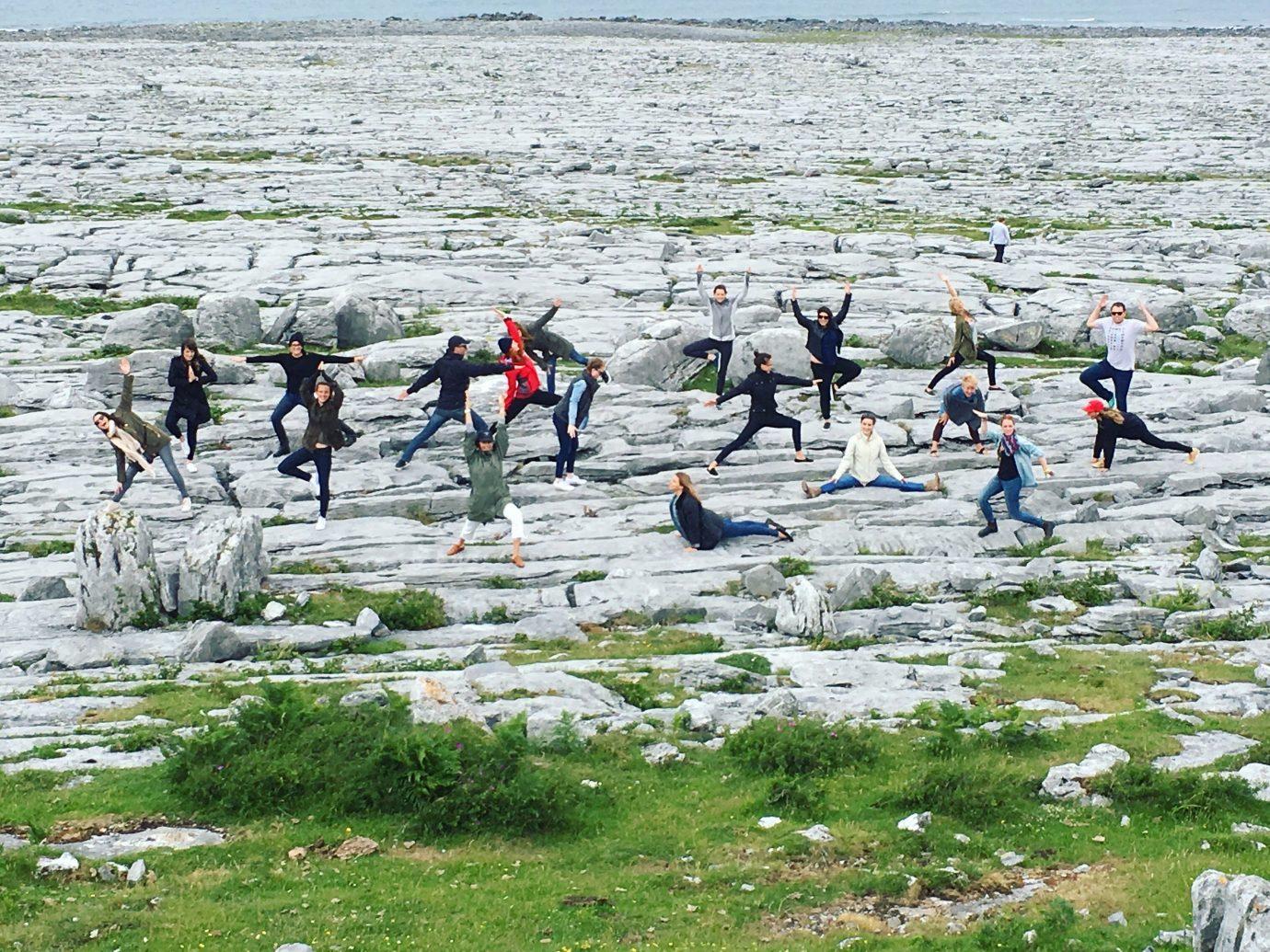 Health + Wellness Meditation Retreats Trip Ideas Yoga Retreats grass outdoor sky group people shore Coast Sea walking wetland