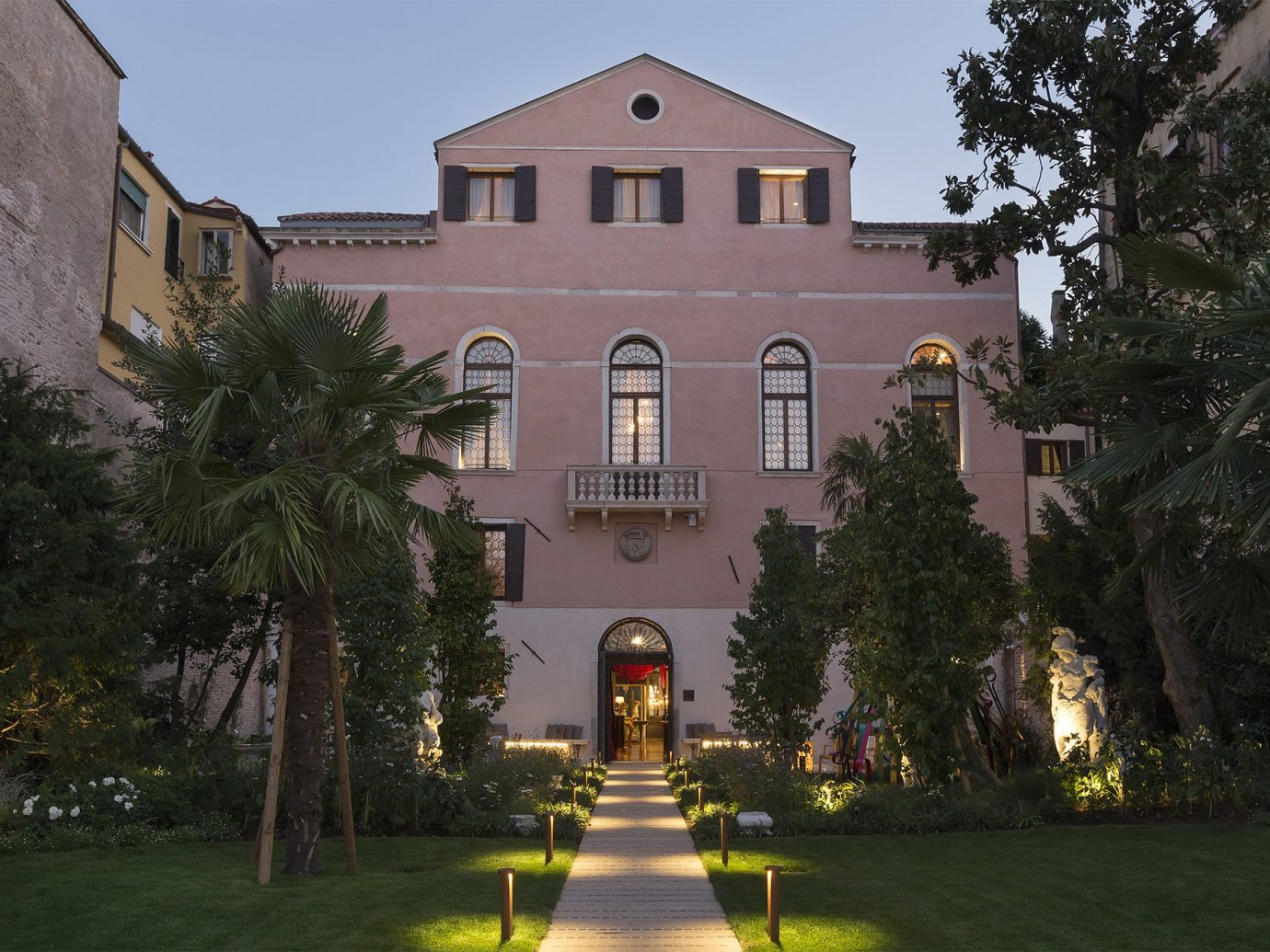 Hotels Italy Luxury Travel Venice mansion estate home property building house Architecture Villa tree residential area real estate lighting facade château evening stately home manor house historic house plant sky medieval architecture window hacienda City landscape lighting